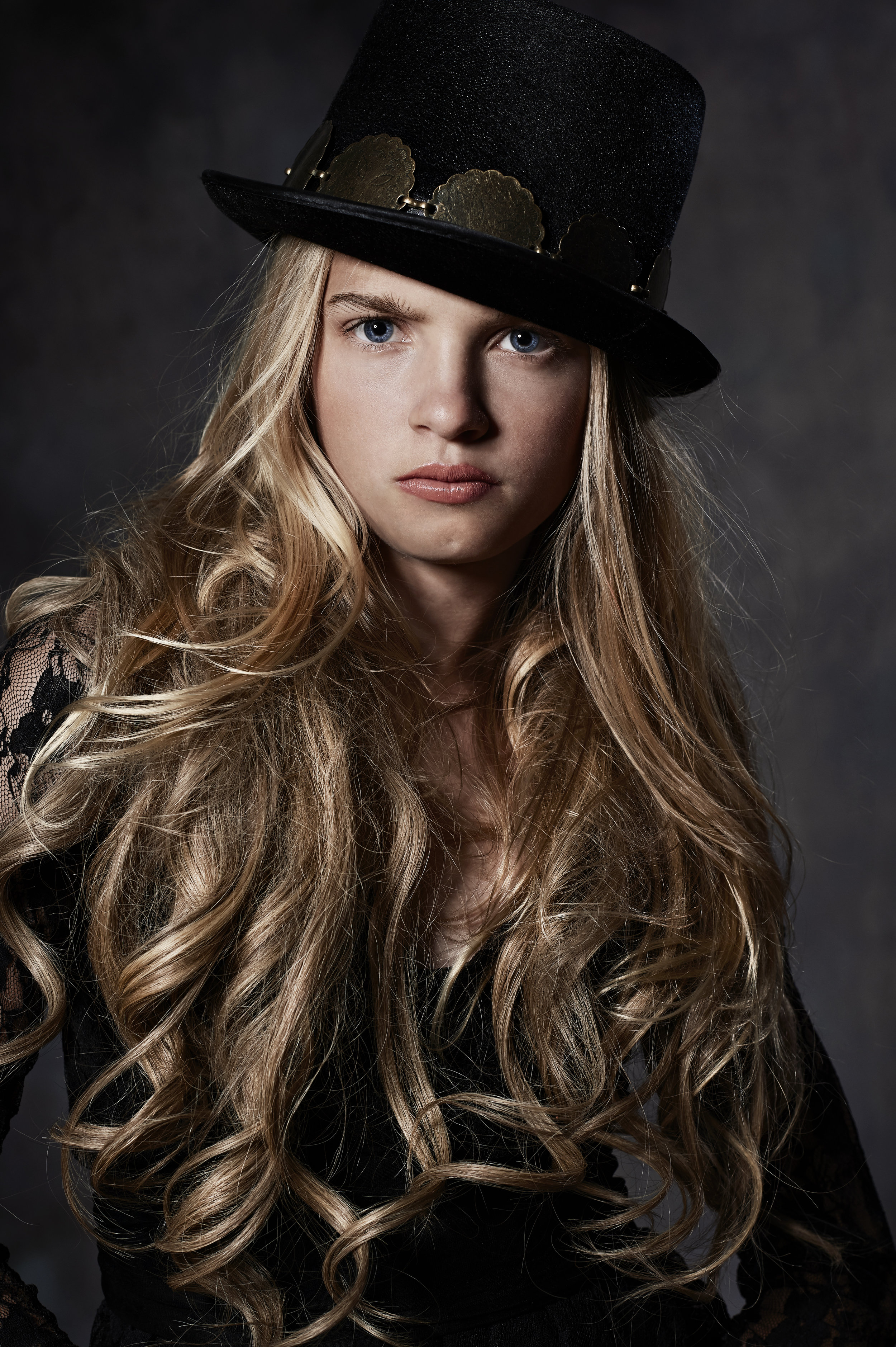 marta hewson - young blonde girl with steampunk top hat.jpg