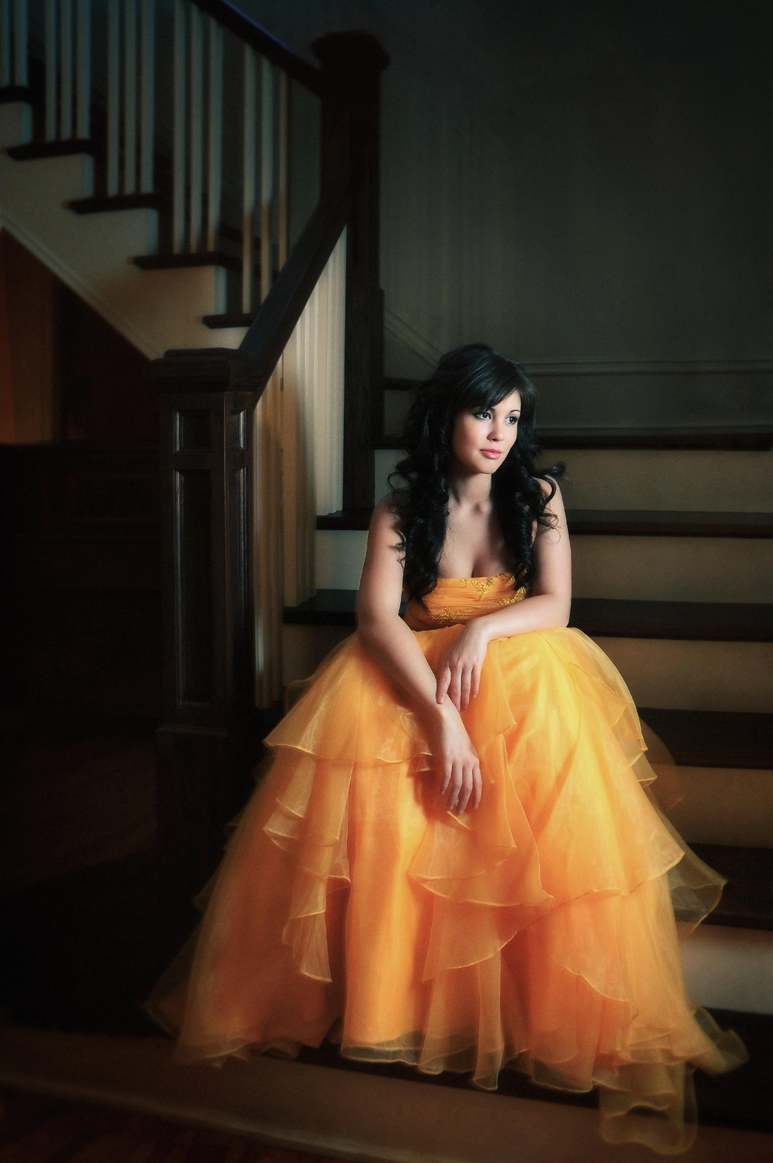 Marta-Hewson-beauty-model-in-bright-orange- dress-on-stairs.jpg