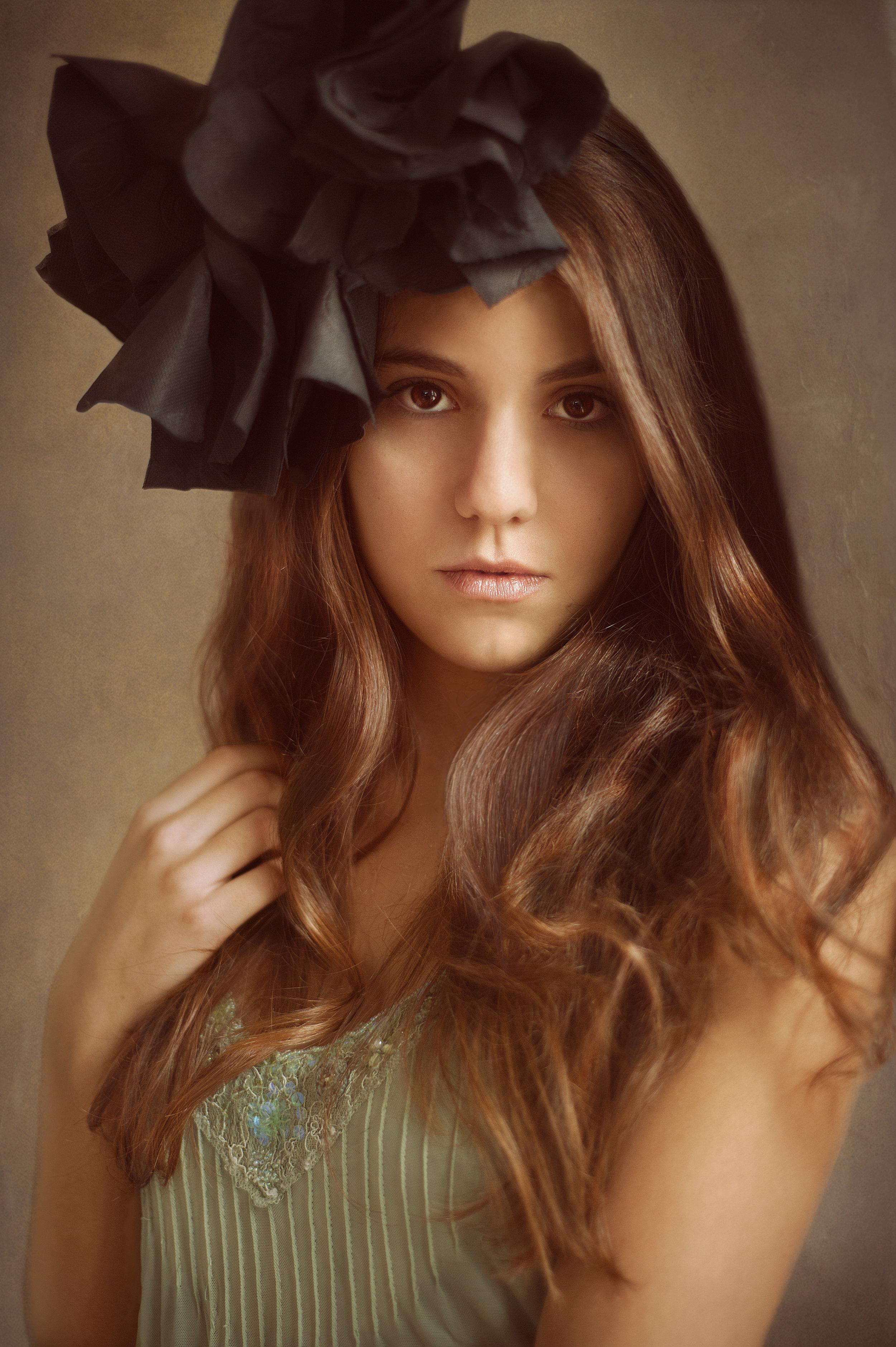 Marta Hewson Portraits - girl with  black flower in her hair.jpg