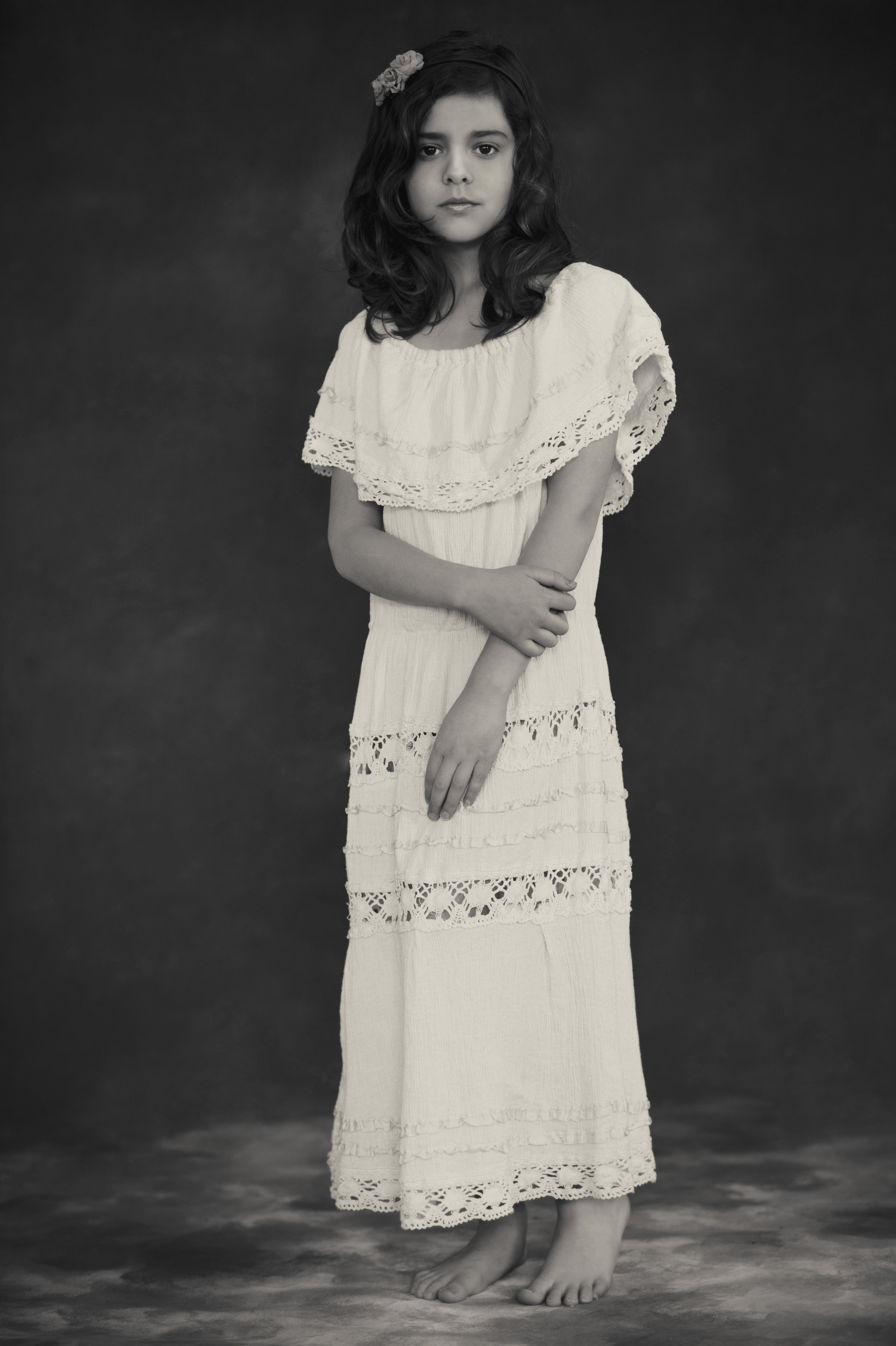 marta-hewson-young-girl-in-white-dress-with-flower-in-her-hair.jpg