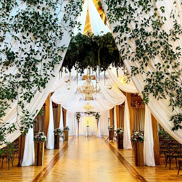 I have never seen a more lovely entrance into a ceremony space. The draping and chandeliers with the gorgeous greenery perfectly highlighted the venue's unique features.  #cheerstotheschweers  Venue: @bridgeportartcenter  Decor by @art_imagination  Flowers by Mike Kennelly  Photo & Video by @thisisfeeling Music & Sound by @davidrothsteinmusic