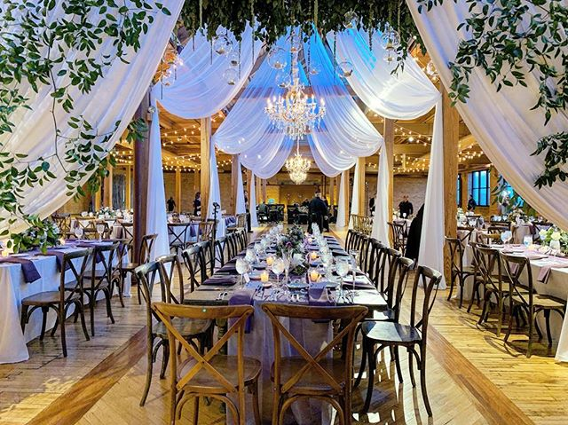 The ceremony space then  transformed into the most romantic space to eat dinner and celebrate!  #cheerstotheschweers  Venue: @bridgeportartcenter  Decor by @art_imagination  Flowers by Mike Kennelly  Photo & Video by @thisisfeeling Music & Sound by @davidrothsteinmusic