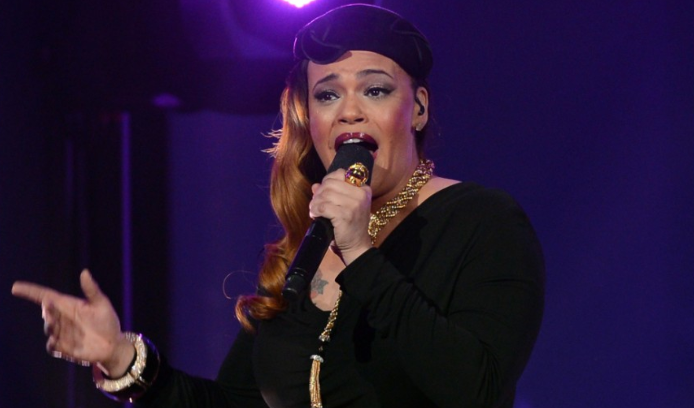 Faith Evans. The signer was born to a black mother and a white father.