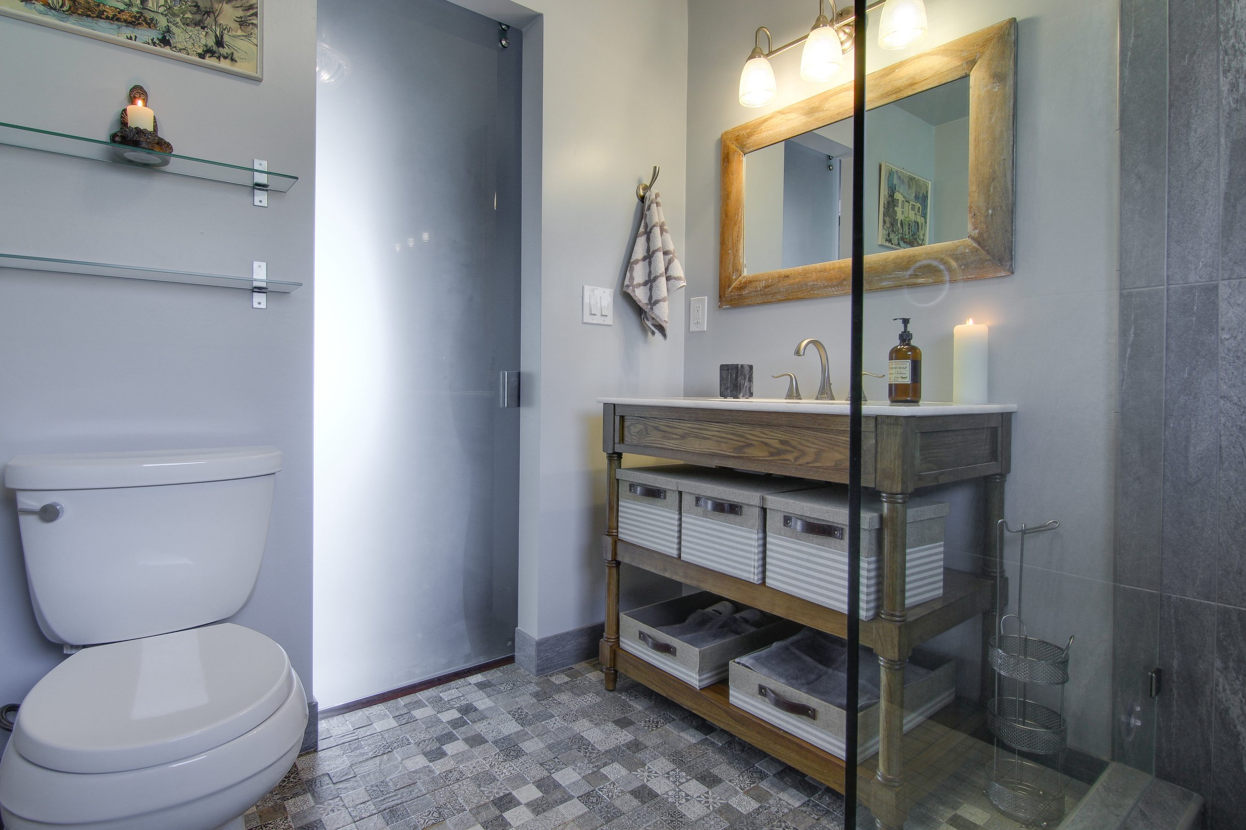 After- The glass barn door illuminates the bathroom with natural light.