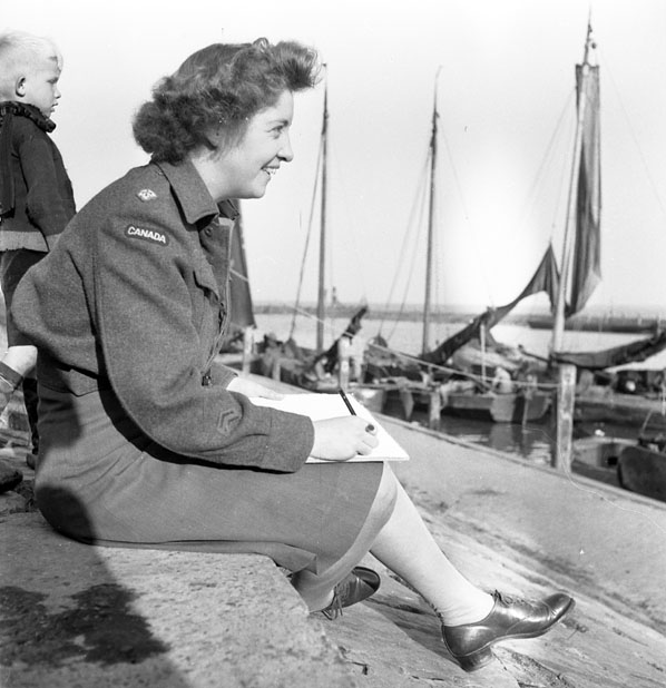 Molly Lamb Bobak sketching boats in Volendam, the Netherlands Photo from the Library and Archives of Canada