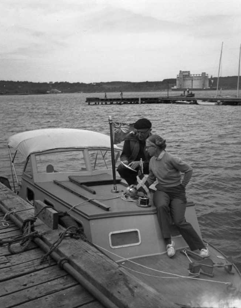 Lucille Olle and her husband Kenneth Wells shown aboard Moonstruck ll, which carried them on a record making 6,000-mile jaunt through U. S. waters in 1956. Photo: The Huronia Museum, ON