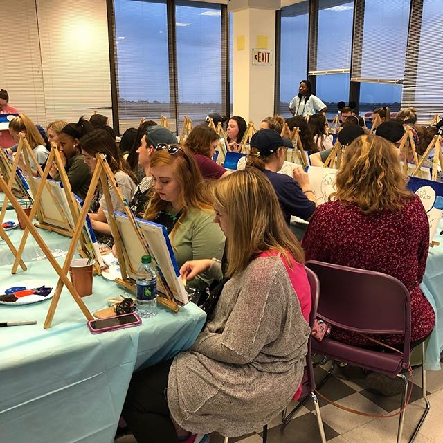 #tbtuesday to painting Auburn Neverland with @auburnupc  #paintingontheplains earlier this semester. There's nothing like painting at sunset in #theeaglesnest 🧡💙🧡💙🦅 #spiritedartao #offsiteevents