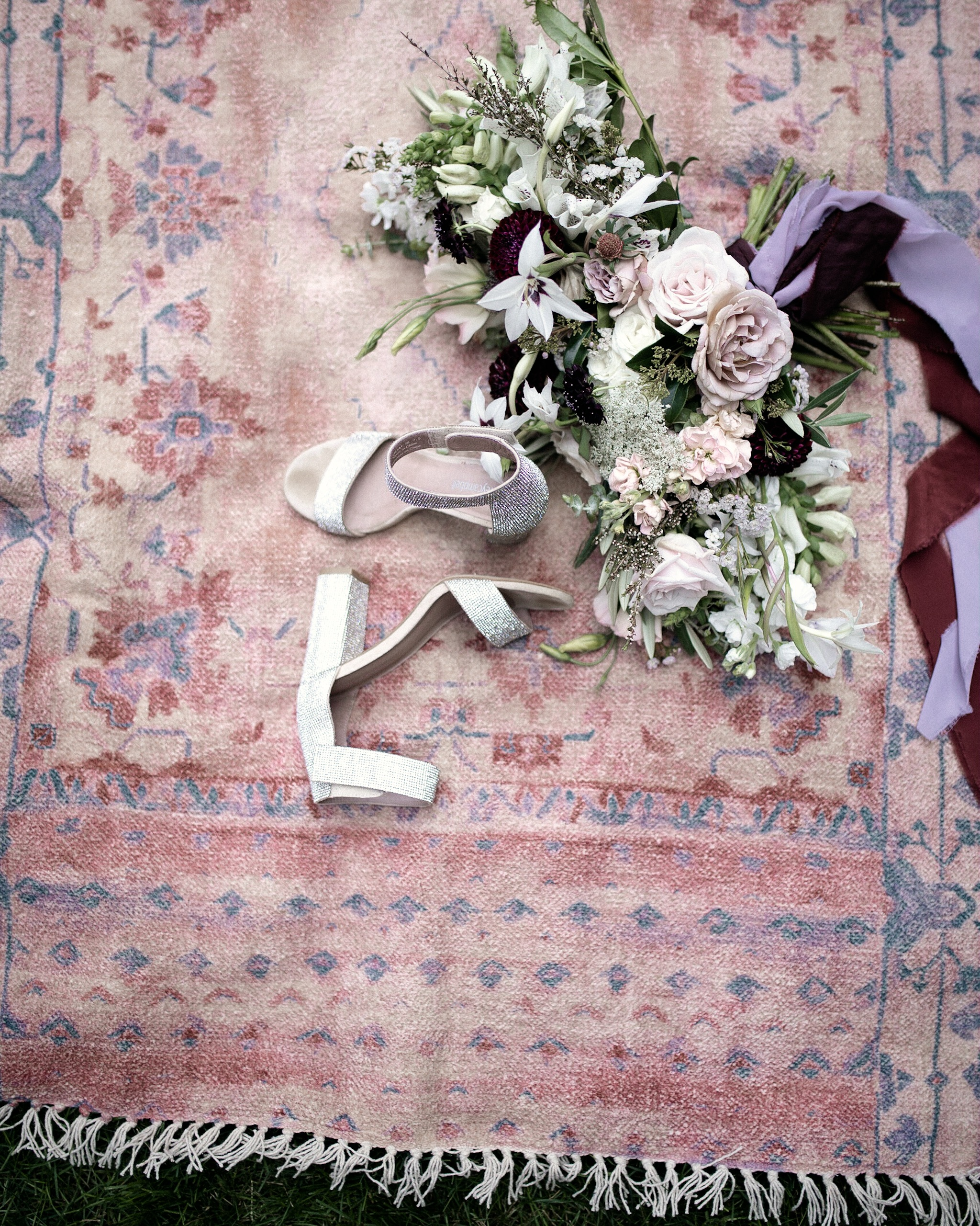 Brier and Ivy Wedding bouquet on vintage rug with brides shoes detail shot