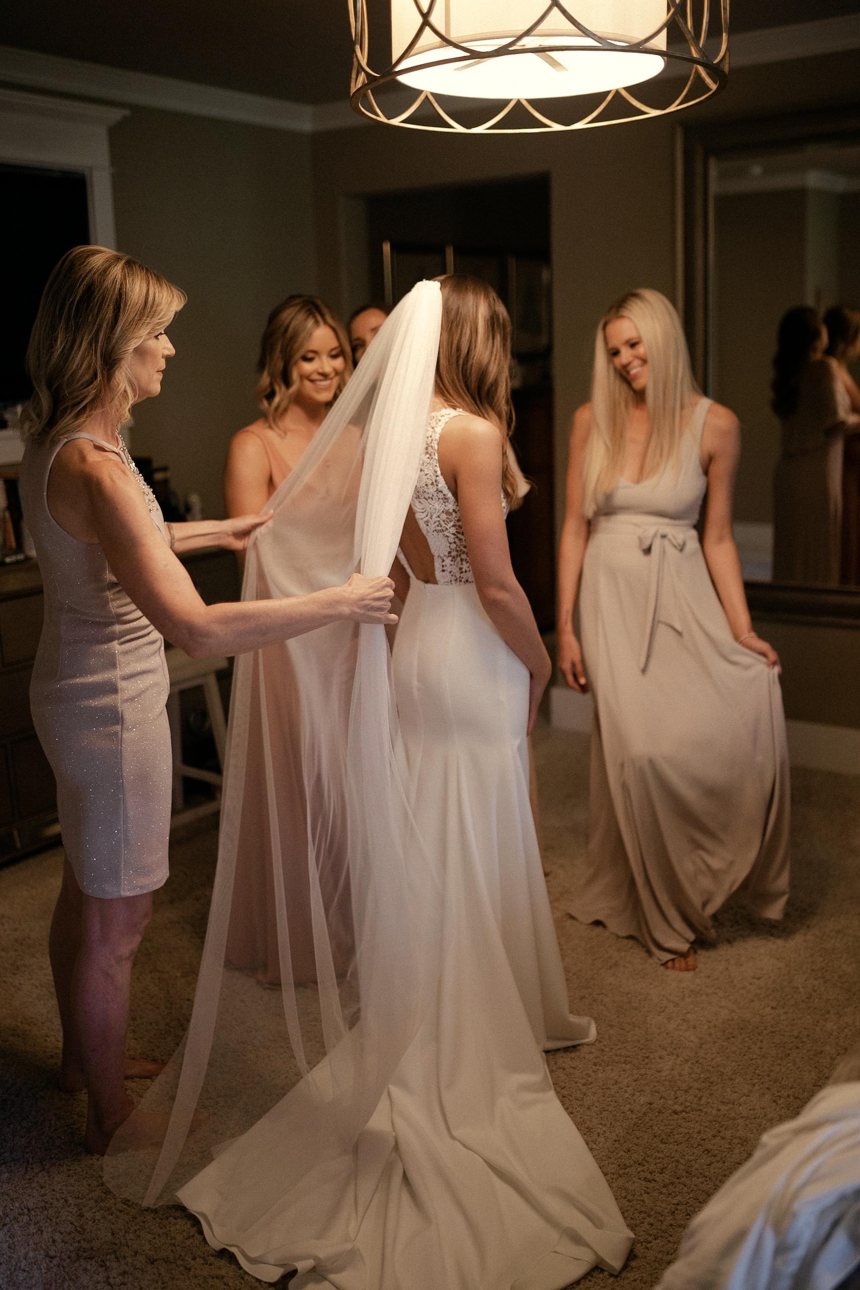 Bride and sisters' dress shot Sarah Seven wedding dress with veil