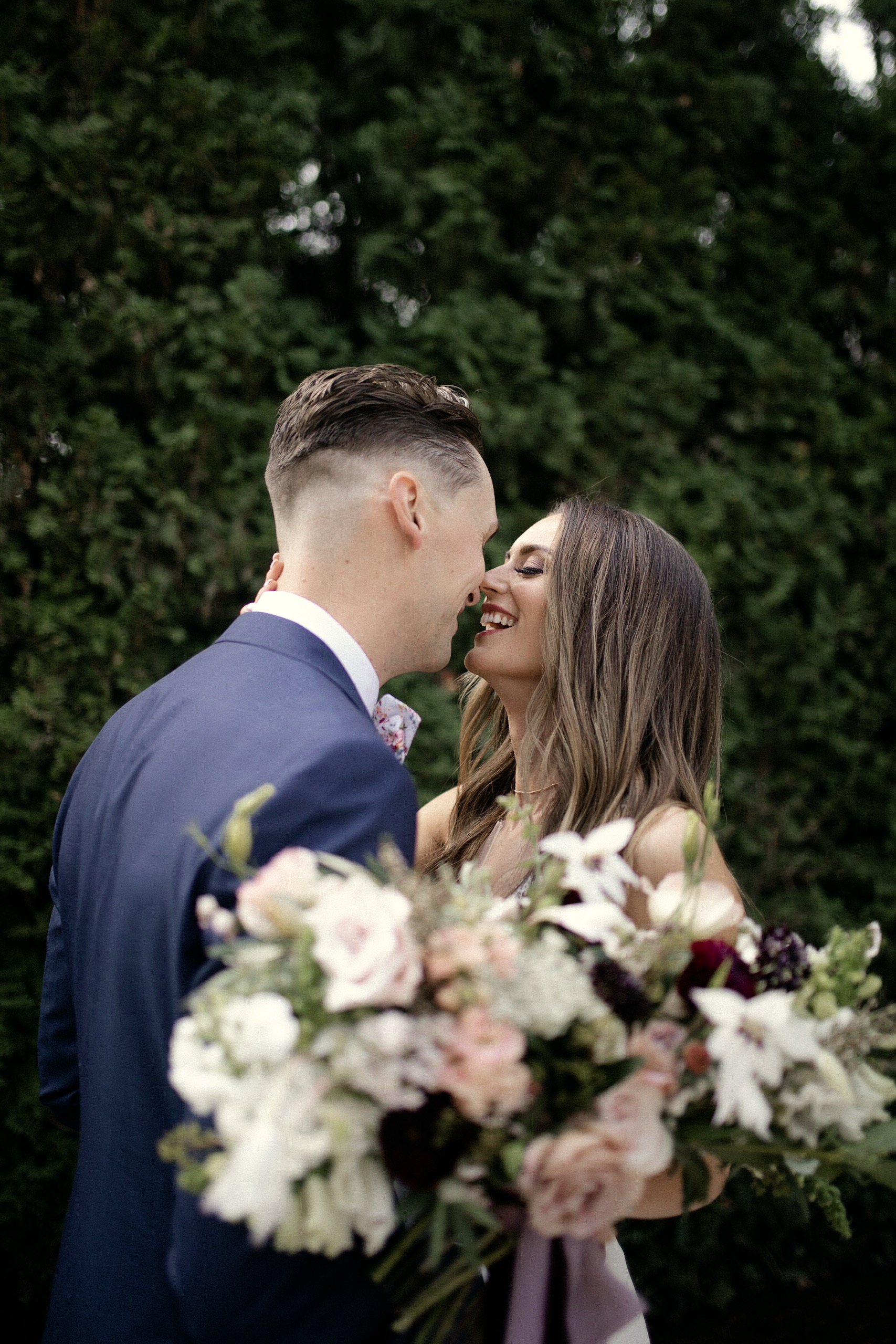 Bride and Groom with wedding florals