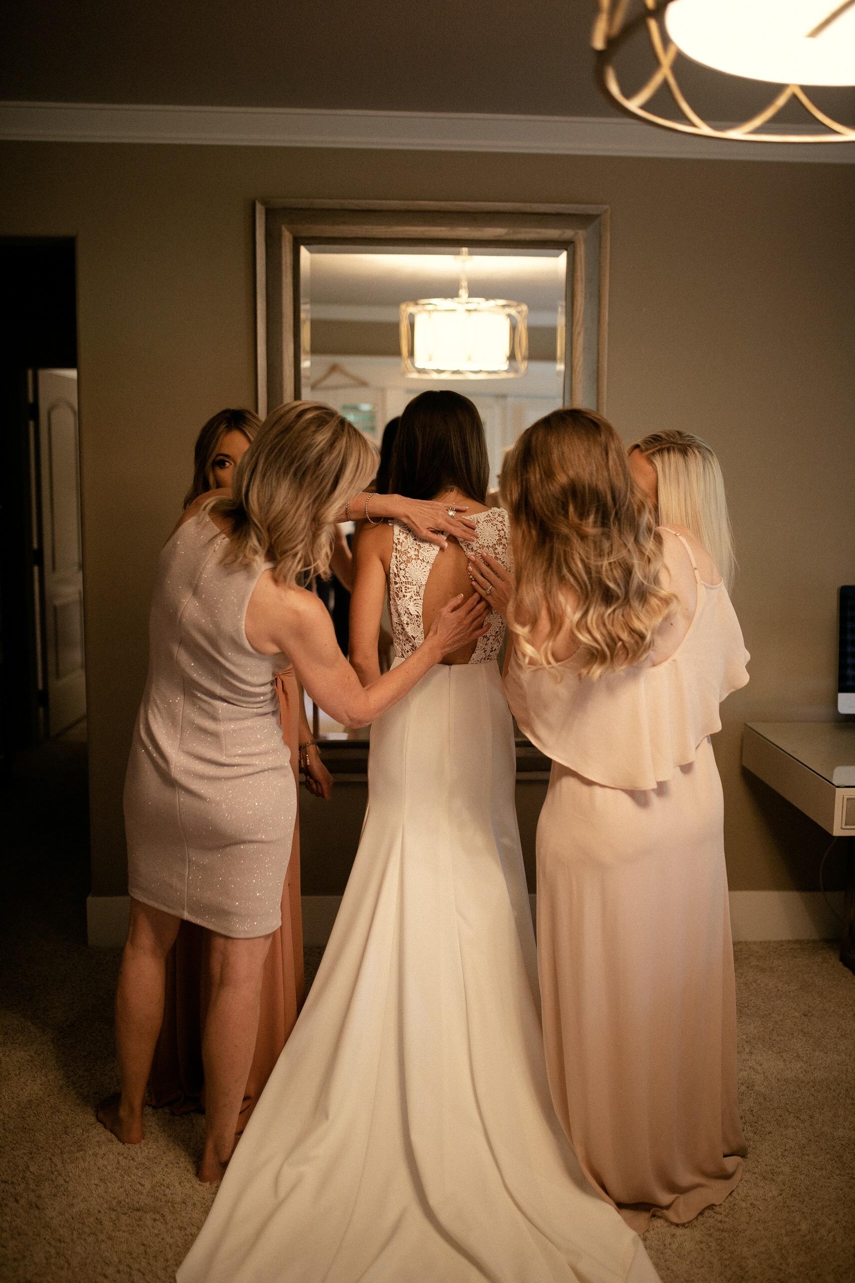 Bride and sisters' dress shot Sarah Seven wedding dress