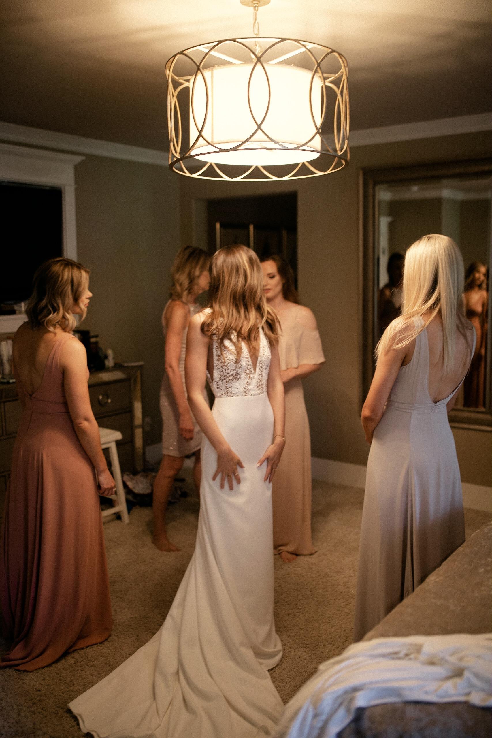 Bride and sisters' dress shot in mirror Sarah Seven wedding dress