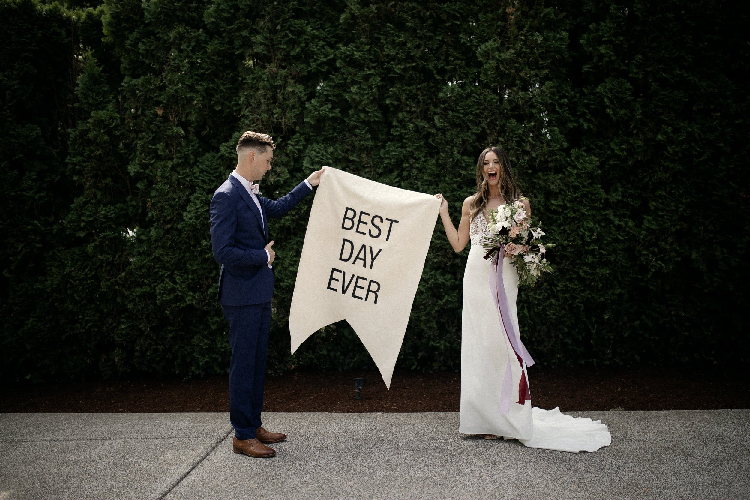 Bride and Groom with Best Day Ever banner