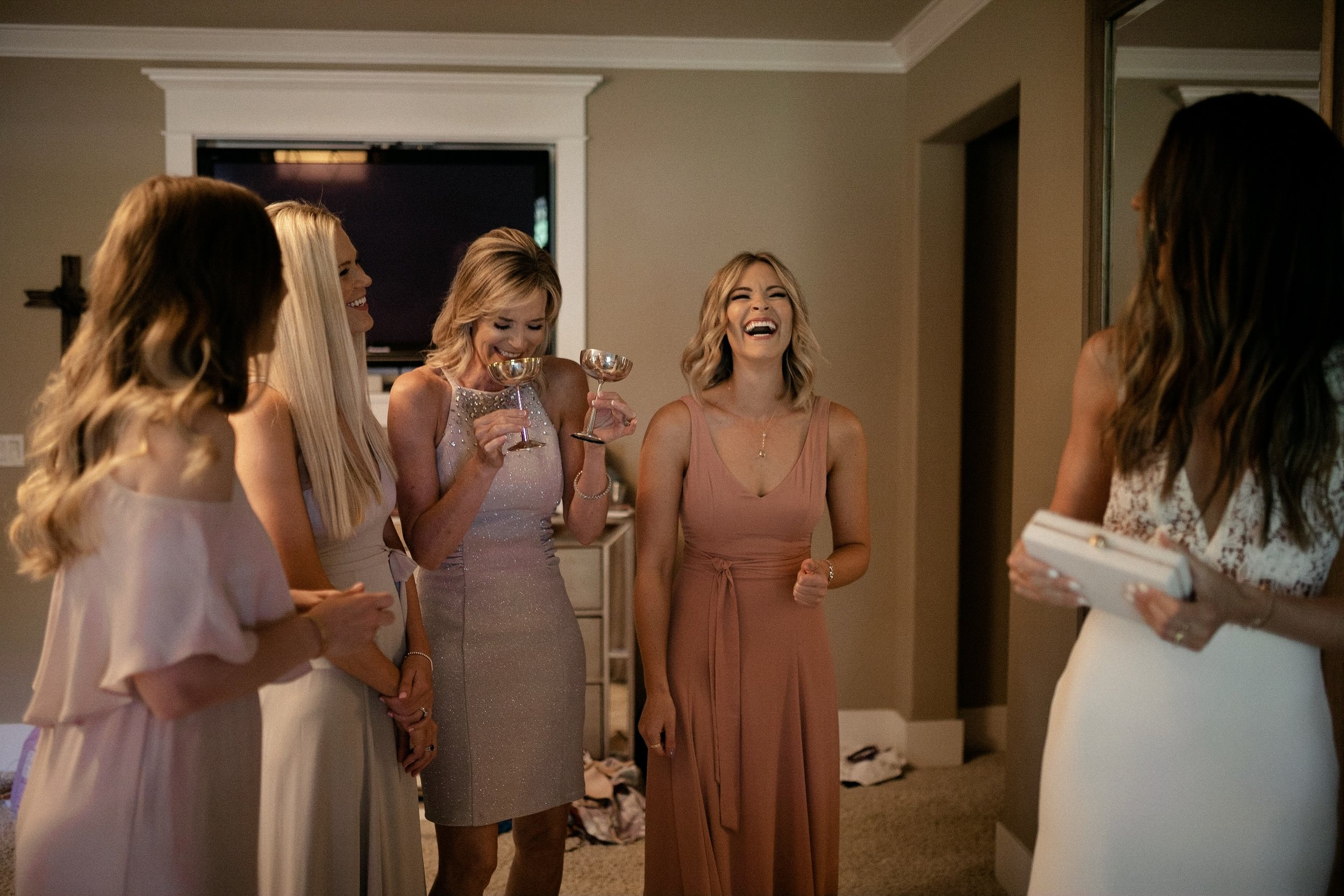 Bride and sisters' laughing
