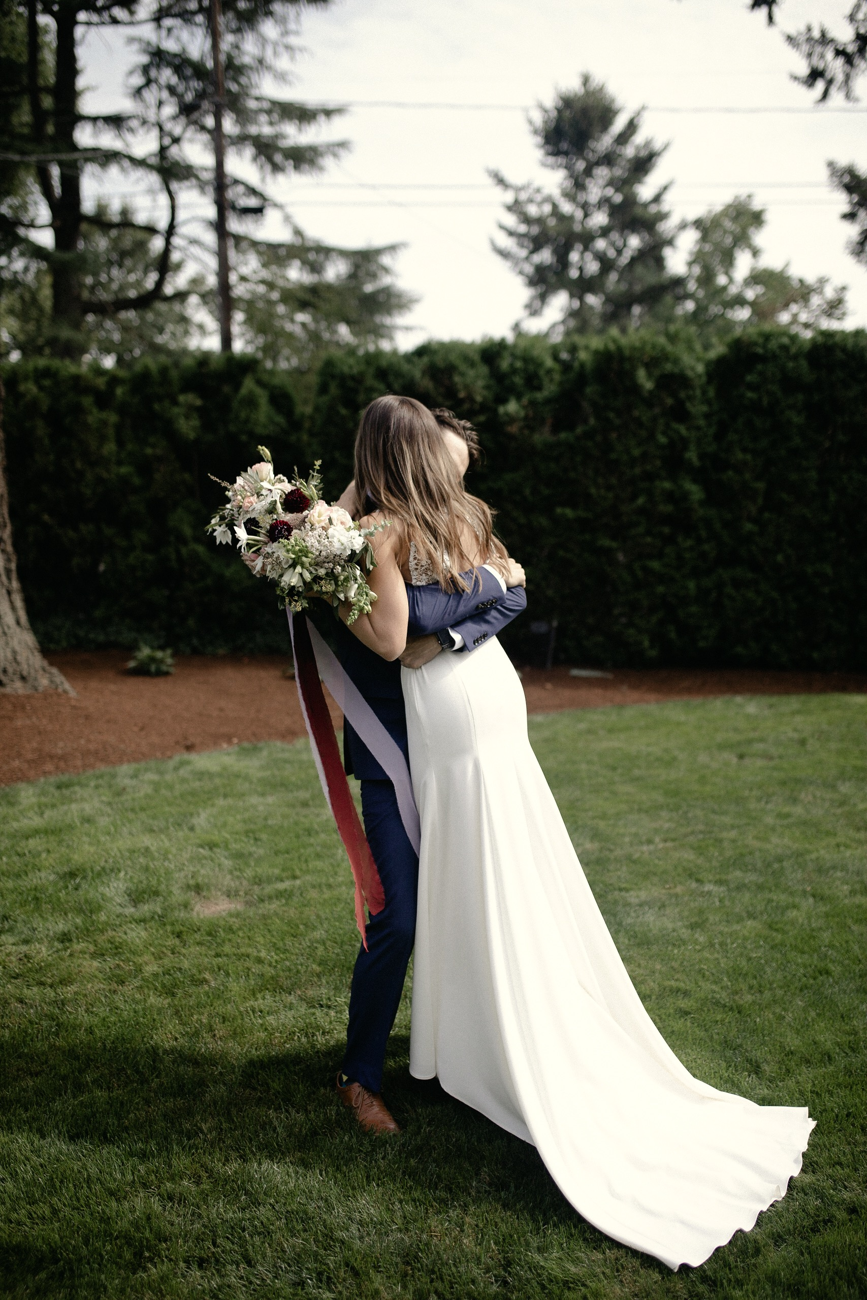 Bride and Groom first look hug Brier and Ivy florals