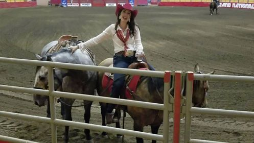 E-Communications Manager Paige Ryan, with Honest Abe (left) and Mouse (right), introduces the press to the Grand National Rodeo at the Cow Palace. (Still from video by Jeff Kaliss)