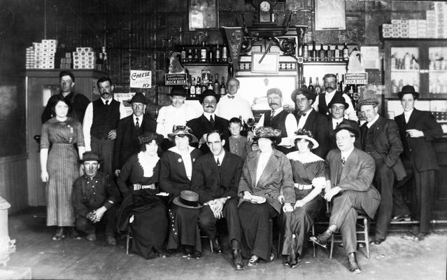 I bet these guys were so proud about what they built.Behind the bar is Egidio Micheli and Palmiro Testa.Lady standing on left side is Eva Testa,Palmiro's daughter. Her future husband, Donald Day,is to her left.