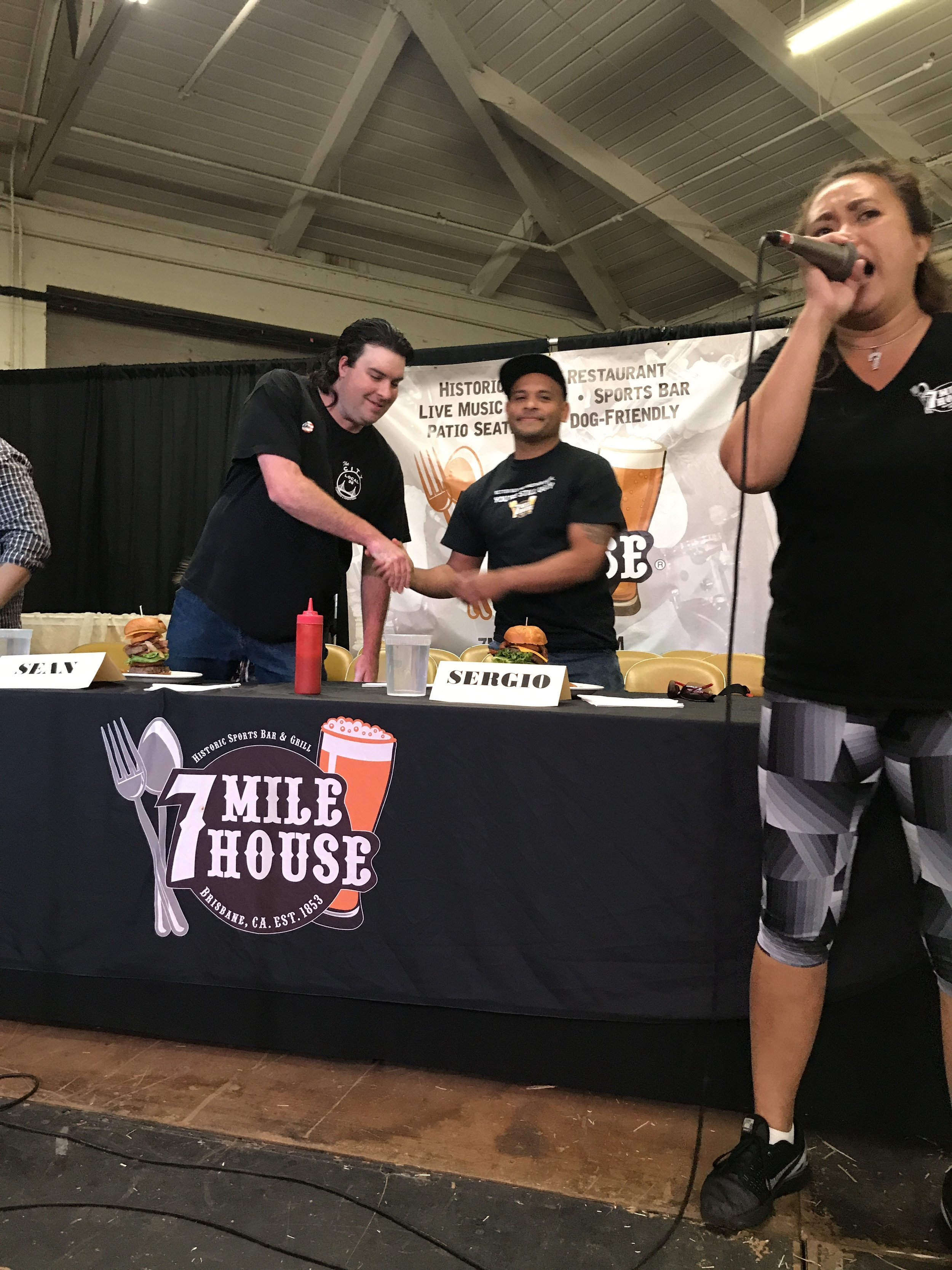 Sean shaking hands before the competition starts with Sergio Raya, last year's Cow Palace Burger King.