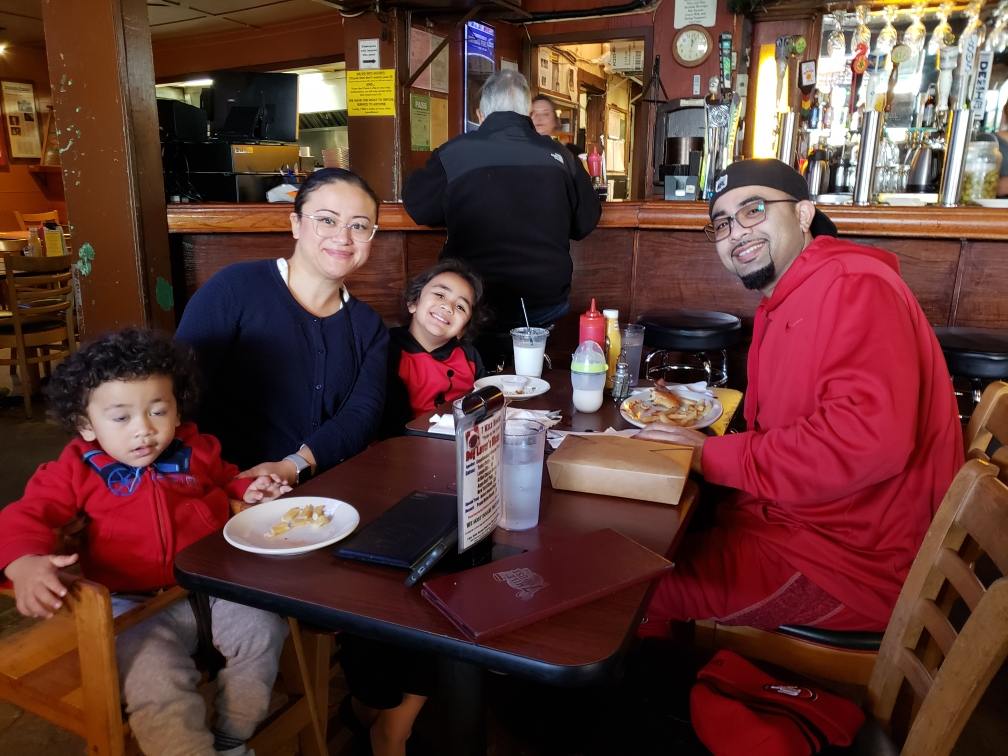 Anthony, Abby, Junior & Noah Ochoa enjoying a meal at the table they met at many years ago!
