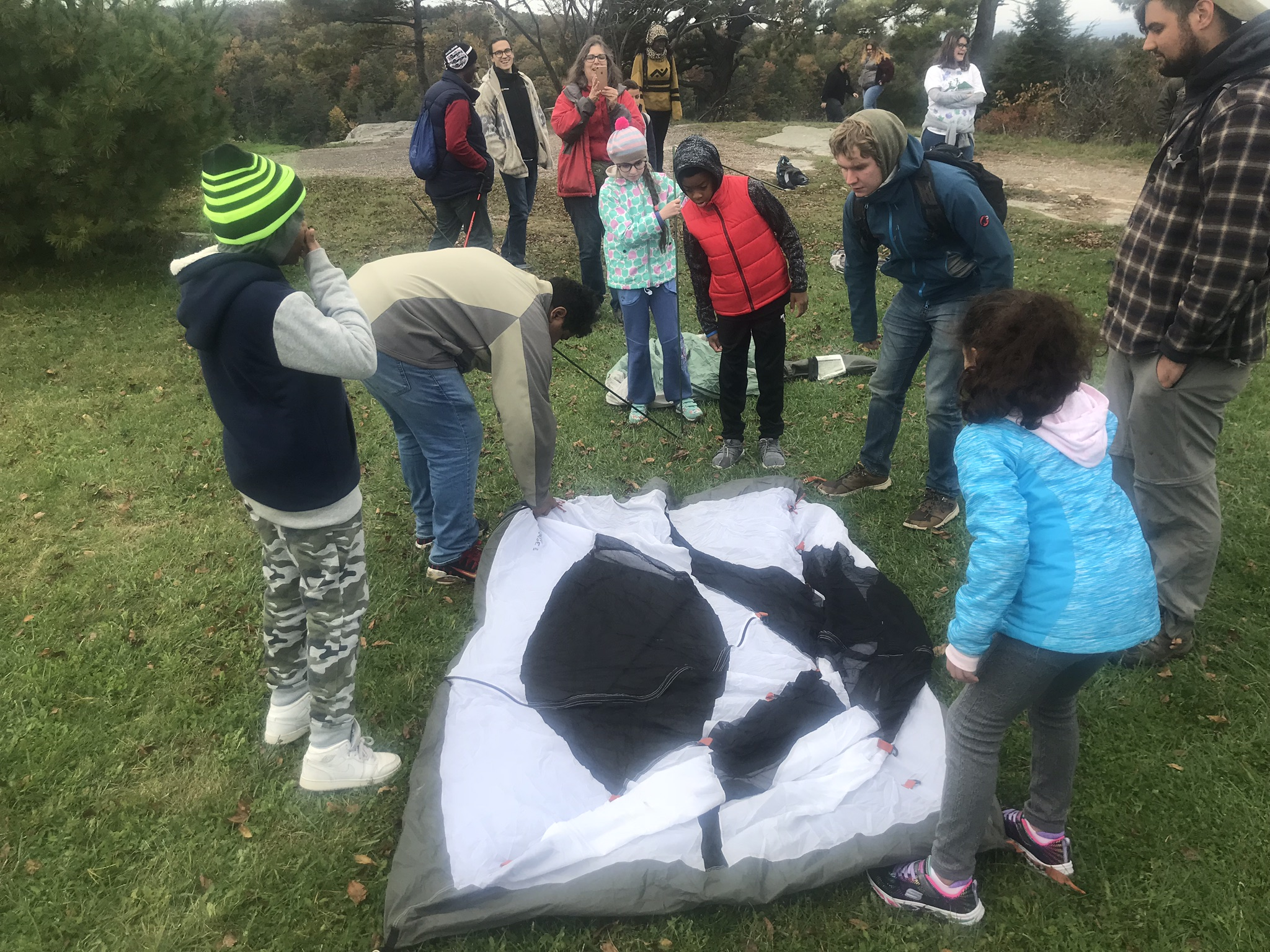 The kids borrow a few mentors to crack the case on putting up a tent!
