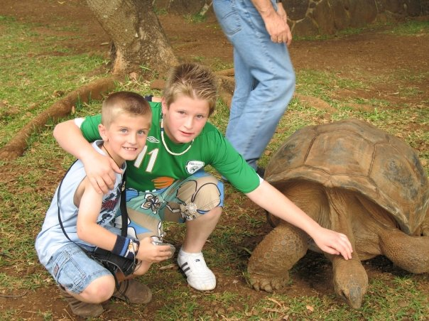 Here I am with my brother, Matt, and a giant tortoise. I apologise unreservedly for my hair and the way I'm dressed here.