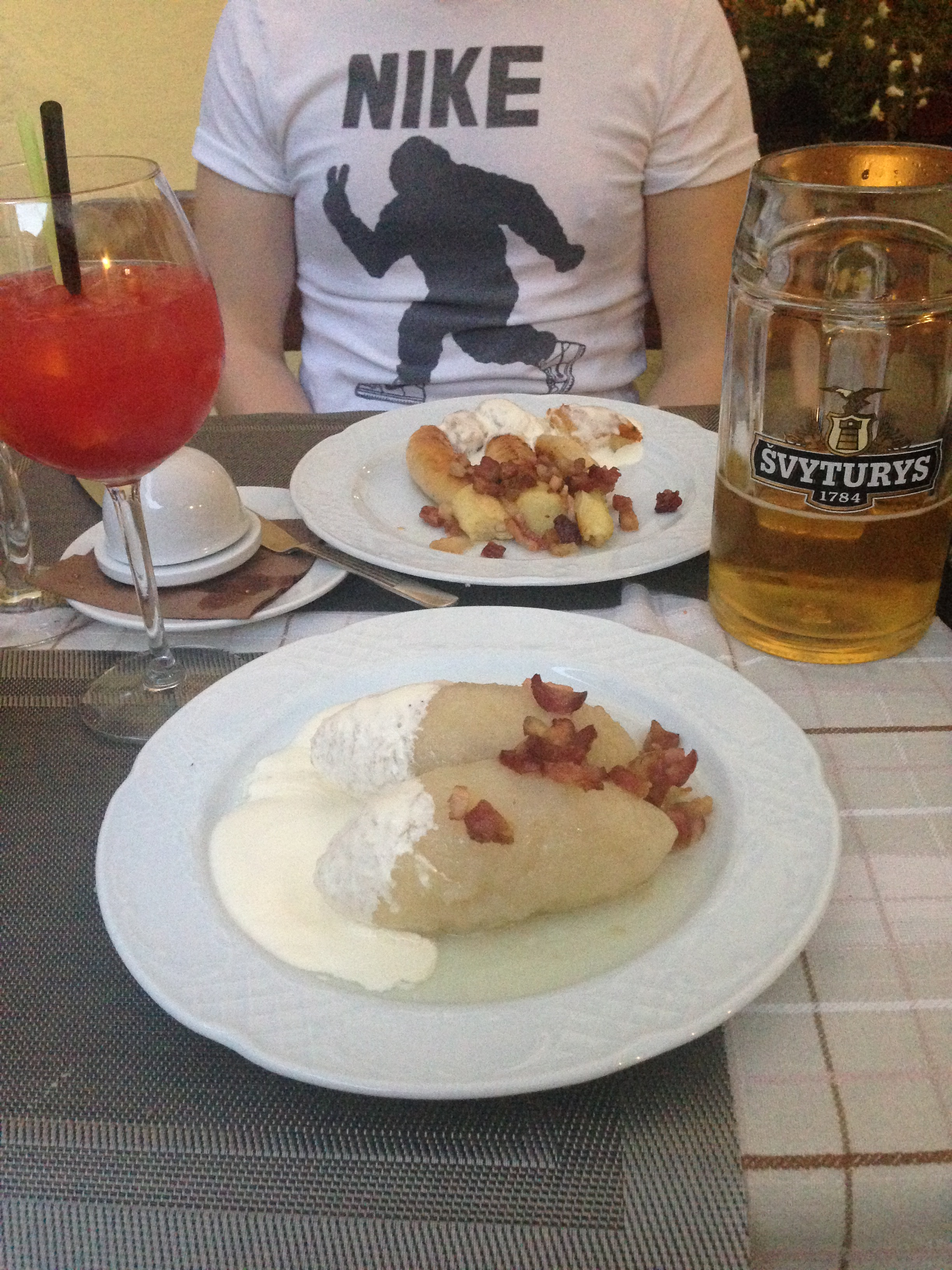 In the foreground are zeppelins - a traditional Lithuanian dish of meat-stuffed potato, served with sour cream and bacon bits - and in the background is potato sausages. The duck breast is also a recommendation.