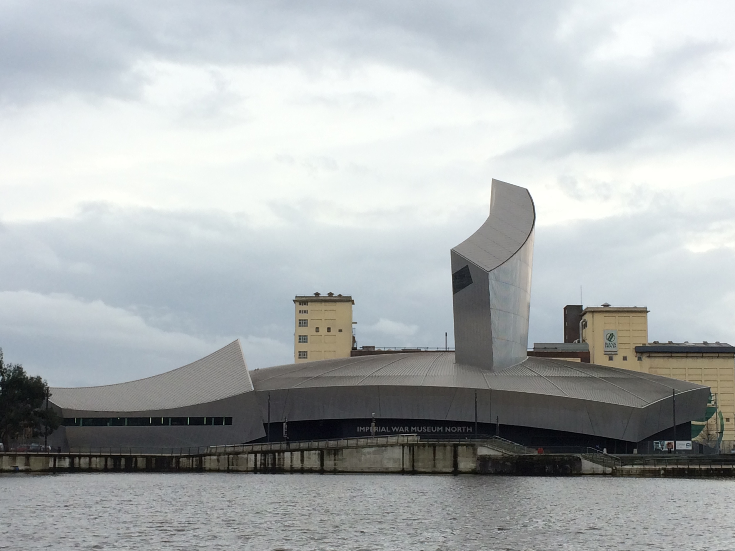 The Imperial War Museum North as seen from the banks of MediaCityUK. The viewing platform can be seen sticking out of the roof.