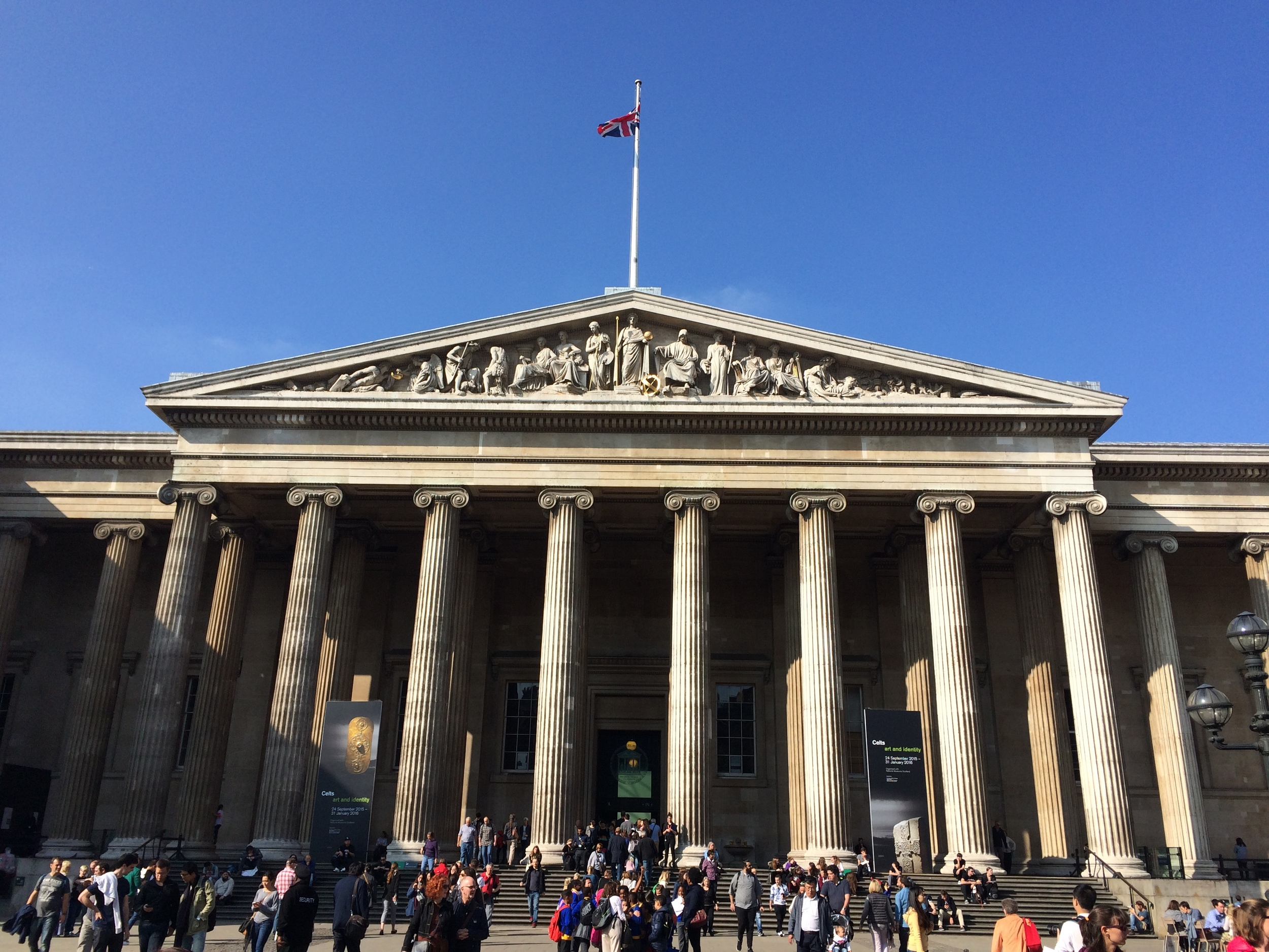 The exterior of the British Museum with the Union Jack flag proudly displayed on top.