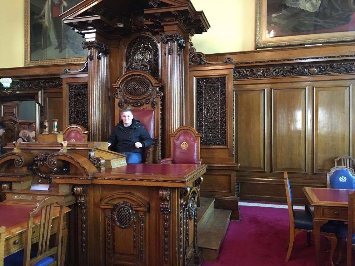 Taking my seat at Belfast City Hall.
