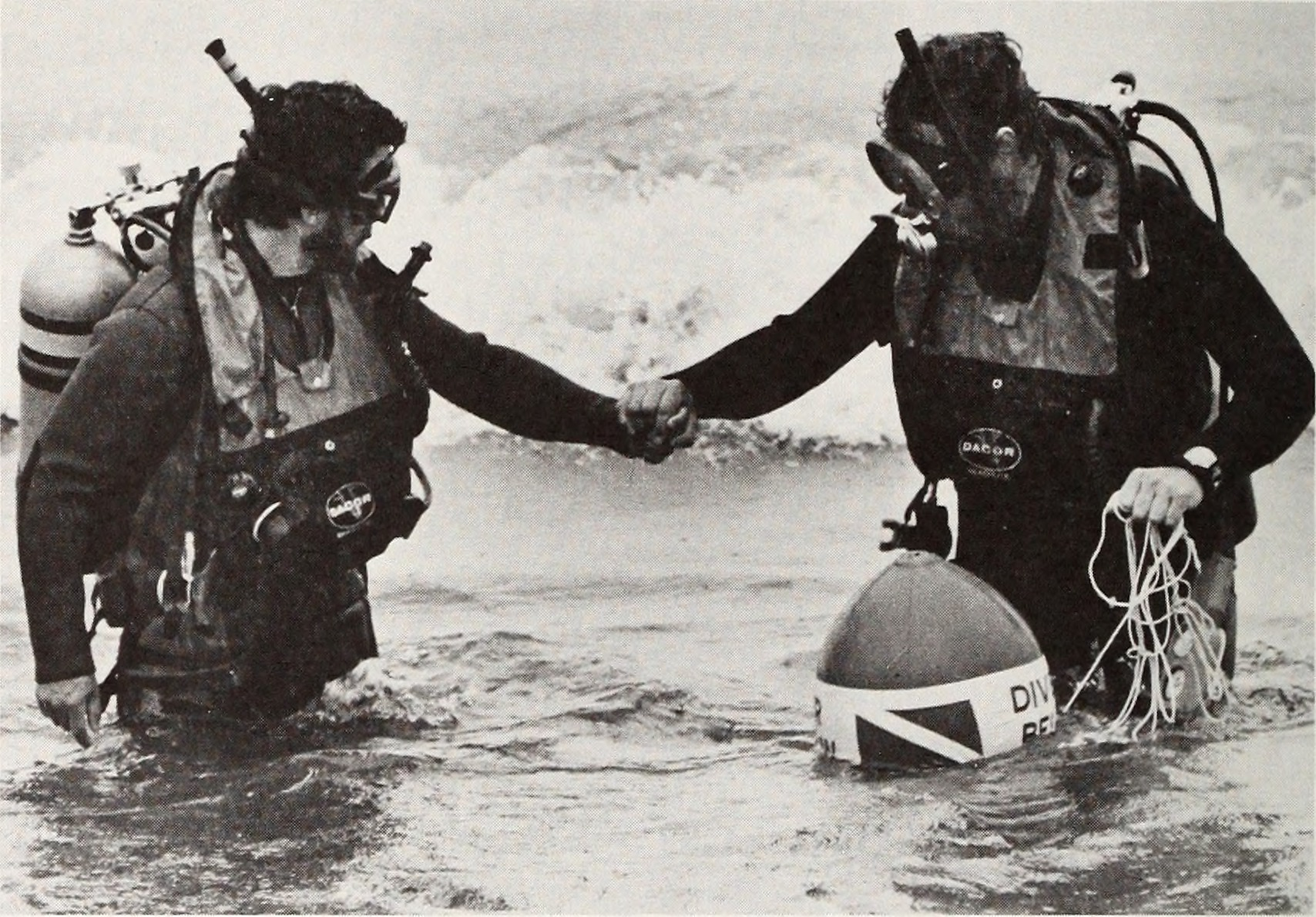Sea-Diving-Holding-Hands-Buoy