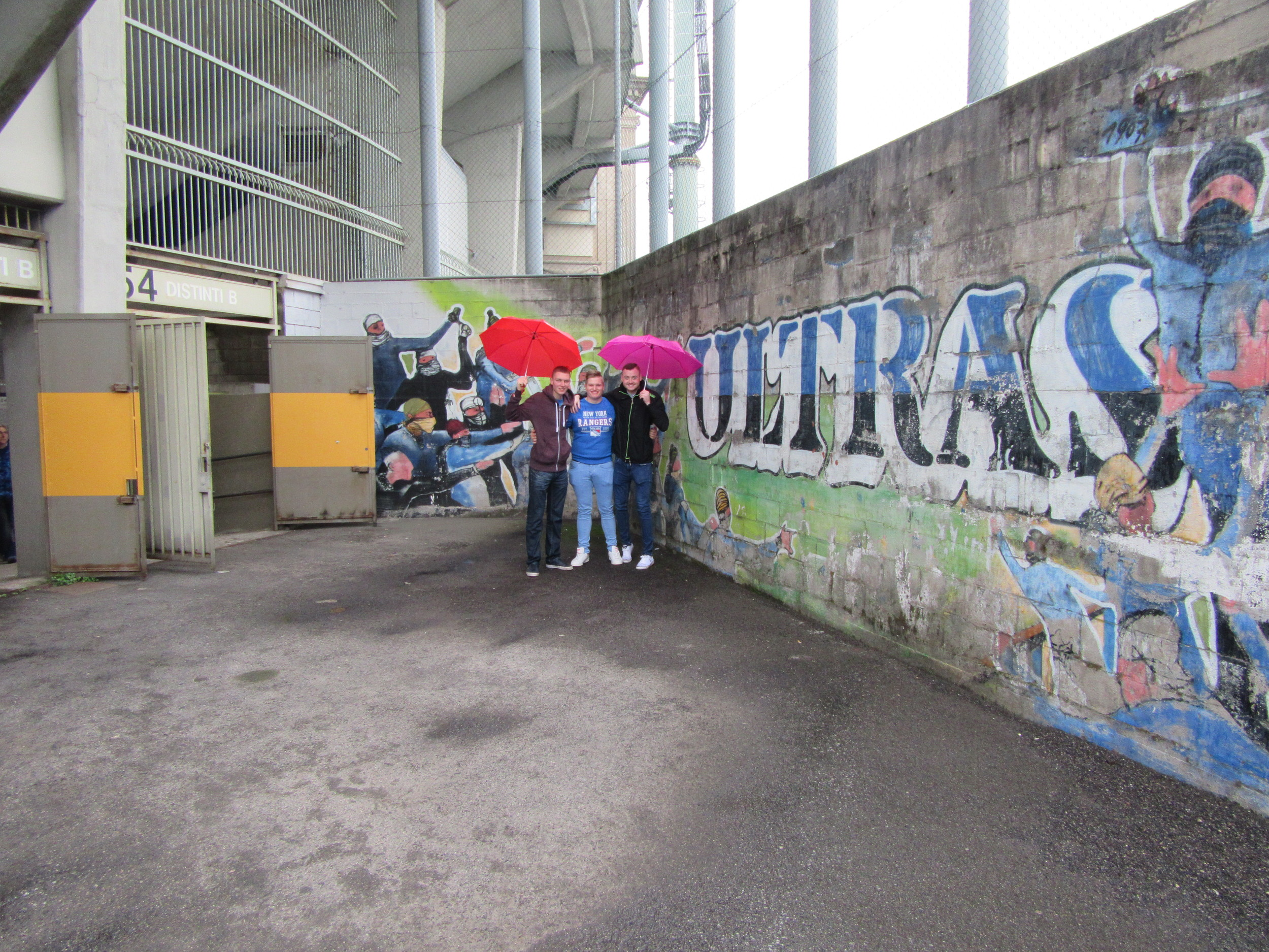 Standing next to the Atalanta 'ULTRAS' mural. You may notice the umbrellas we purchased before the game, which prevented us going from zero to drowned rats in five minutes.