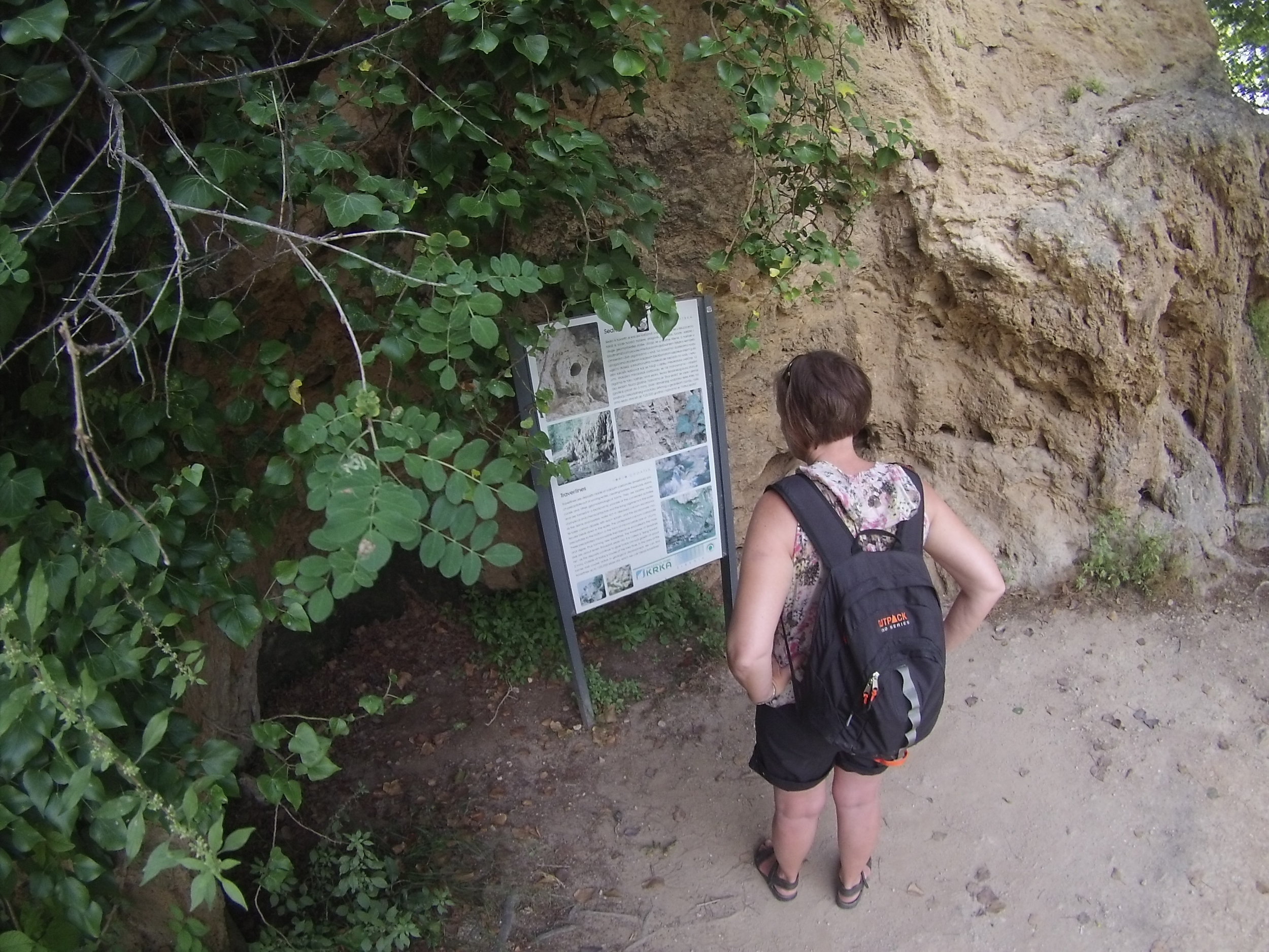 A woman reads one of the information boards at Krka National Park.