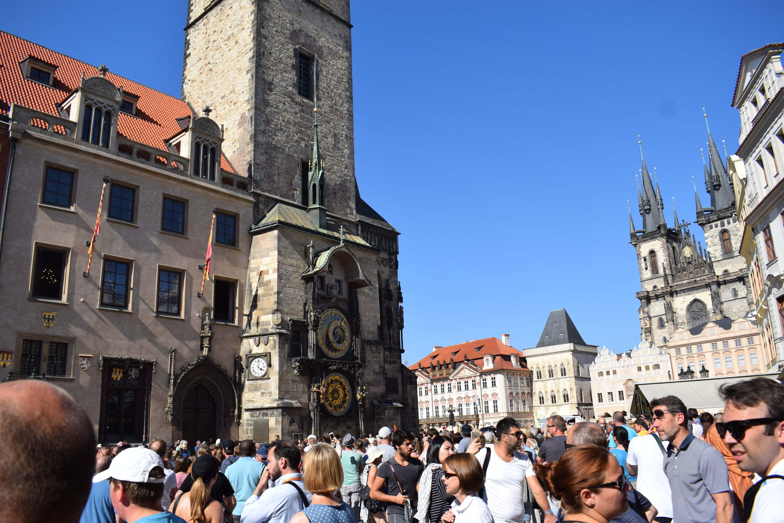 Masses of people flock to the Astronomical Clock just before the hour to witness it chime.