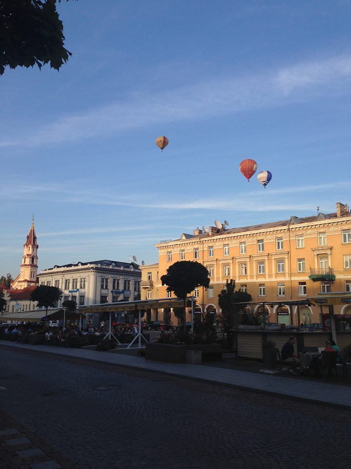 A heart warming look at the sunset from Old Town Square, illuminating Vilnius' beauty.