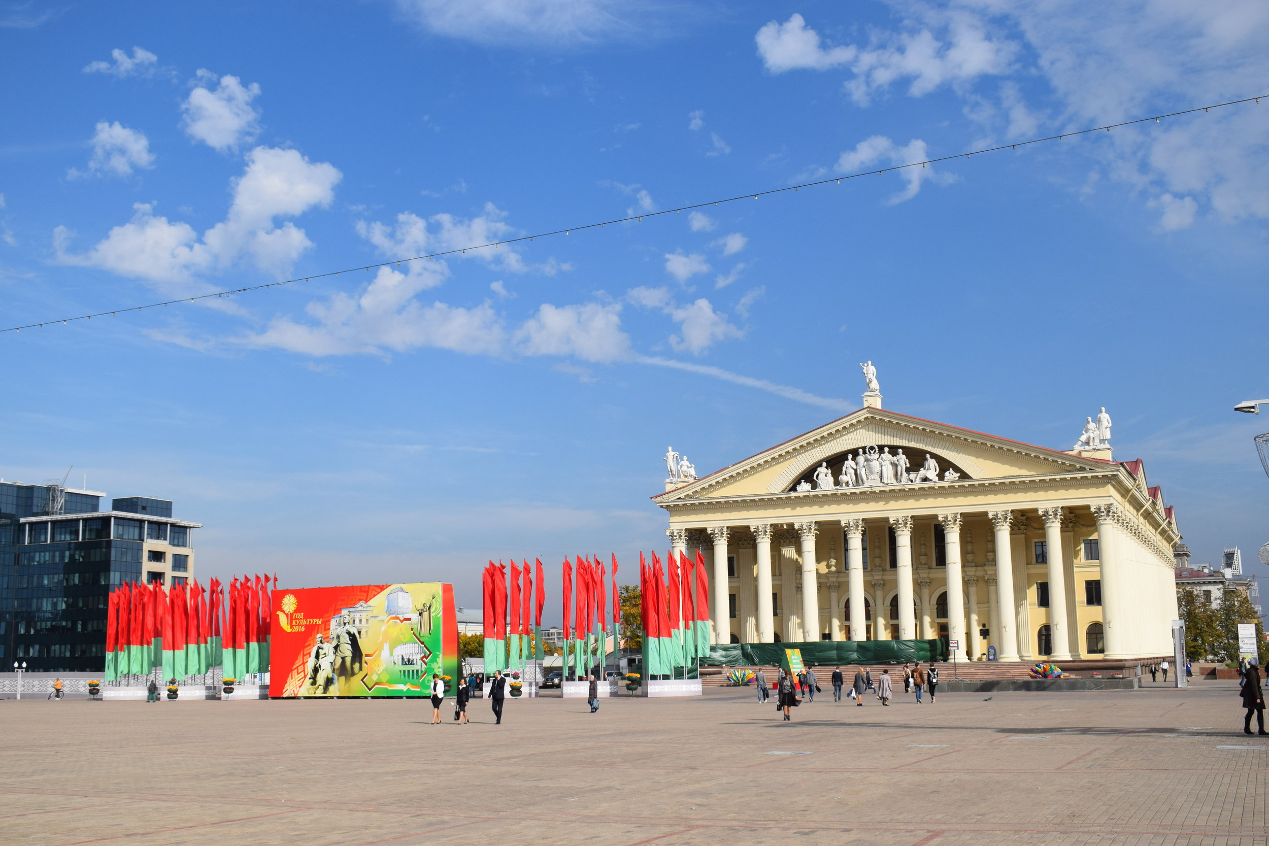 Minsk's cultural centre with a collection of flags outside in the colours of the Belarus flag.