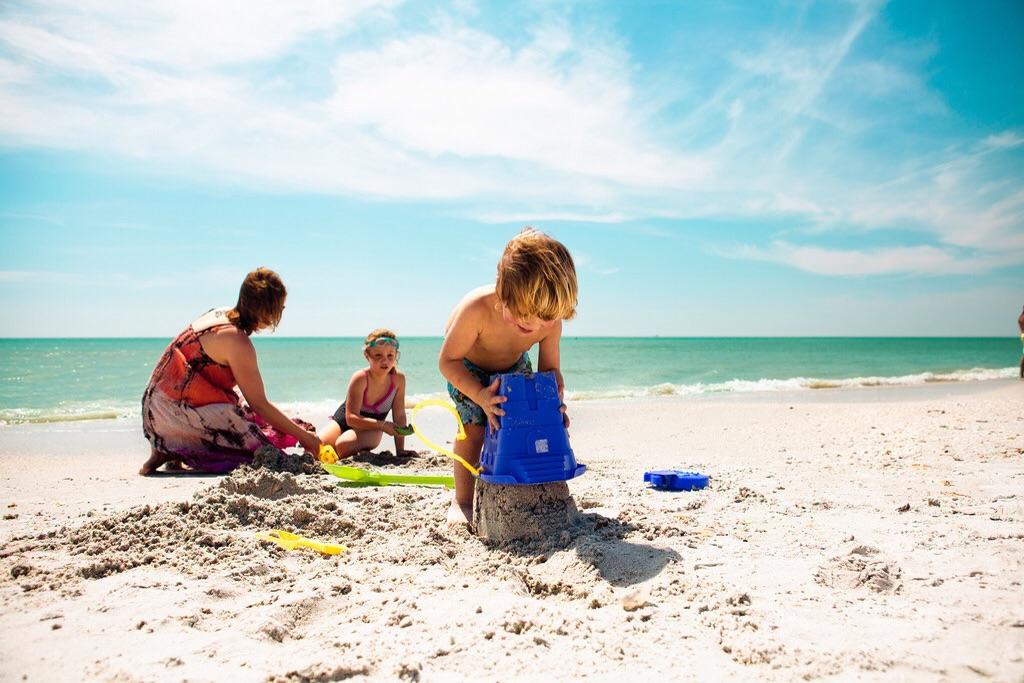 Family-Beach-Holiday-Sandcastle