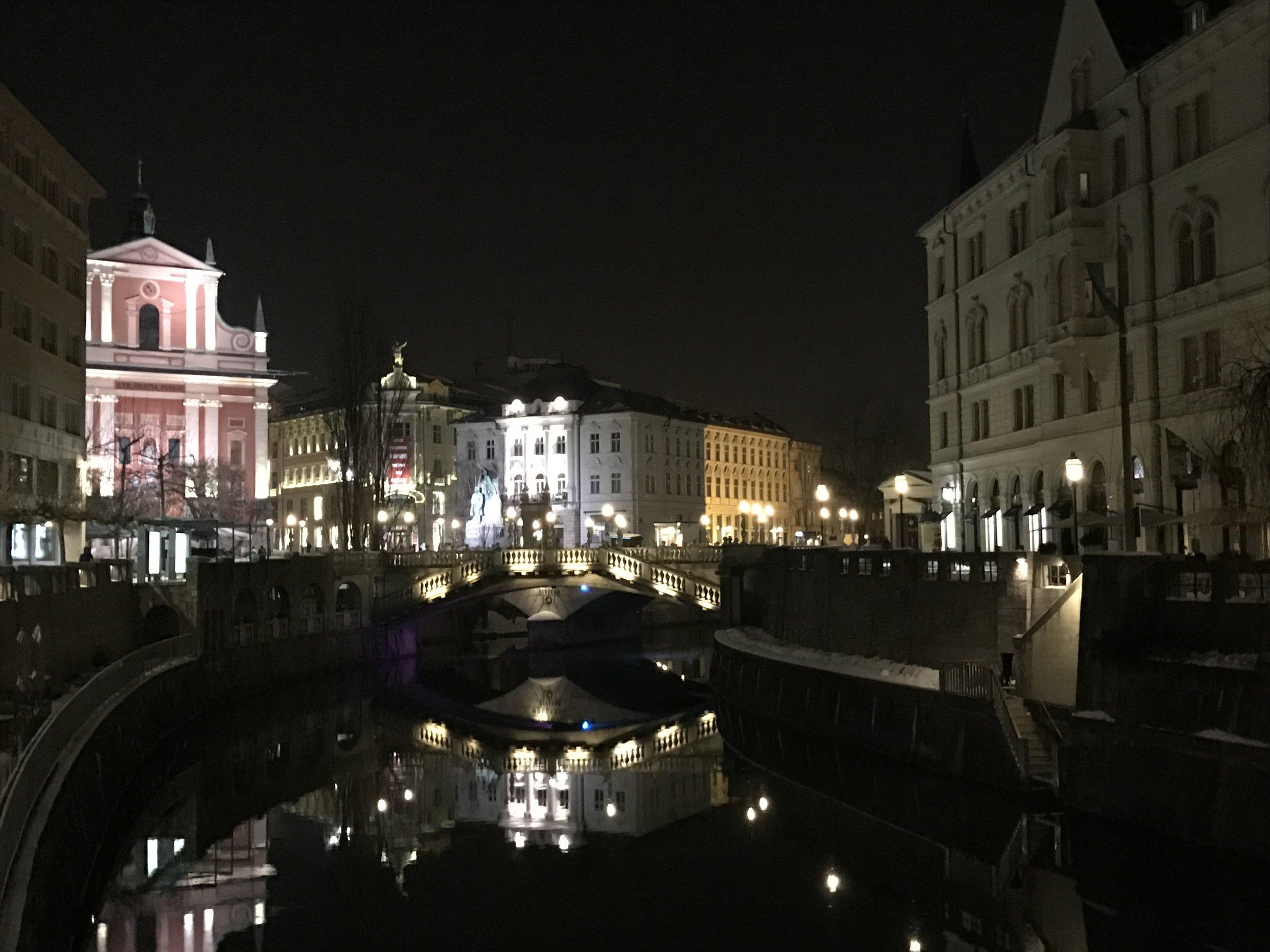 Ljubljana by night, featuring the illumination of the Triple Bridge.