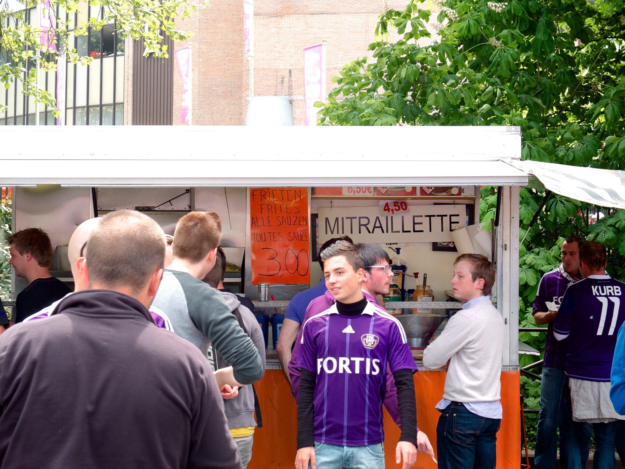 Vendors like the one pictured above serve fast food outside Constant Vanden Stock Stadion. Image credit:    Sander Spek   /   Flickr