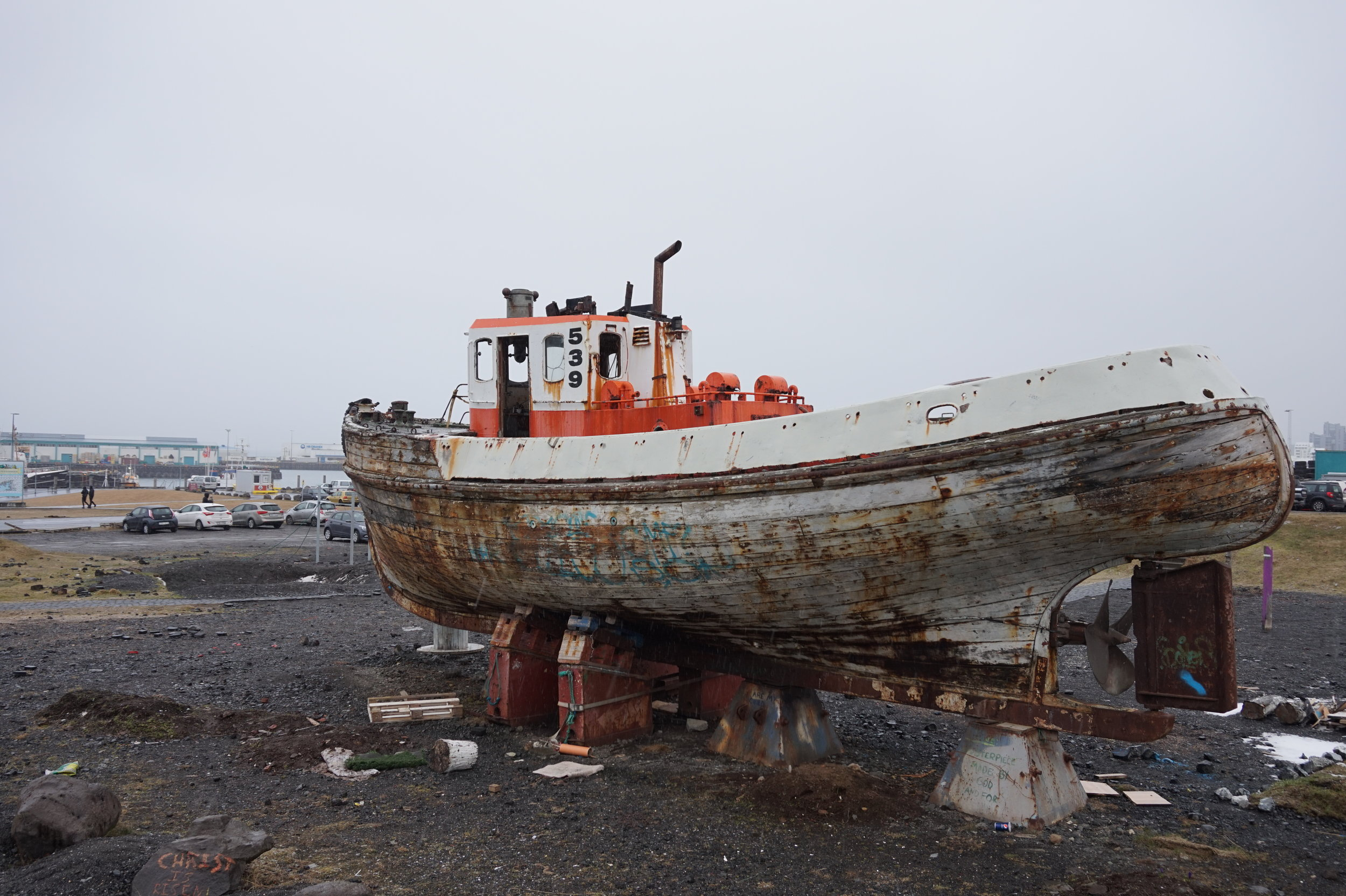 A seemingly abandoned lifeboat near the port.