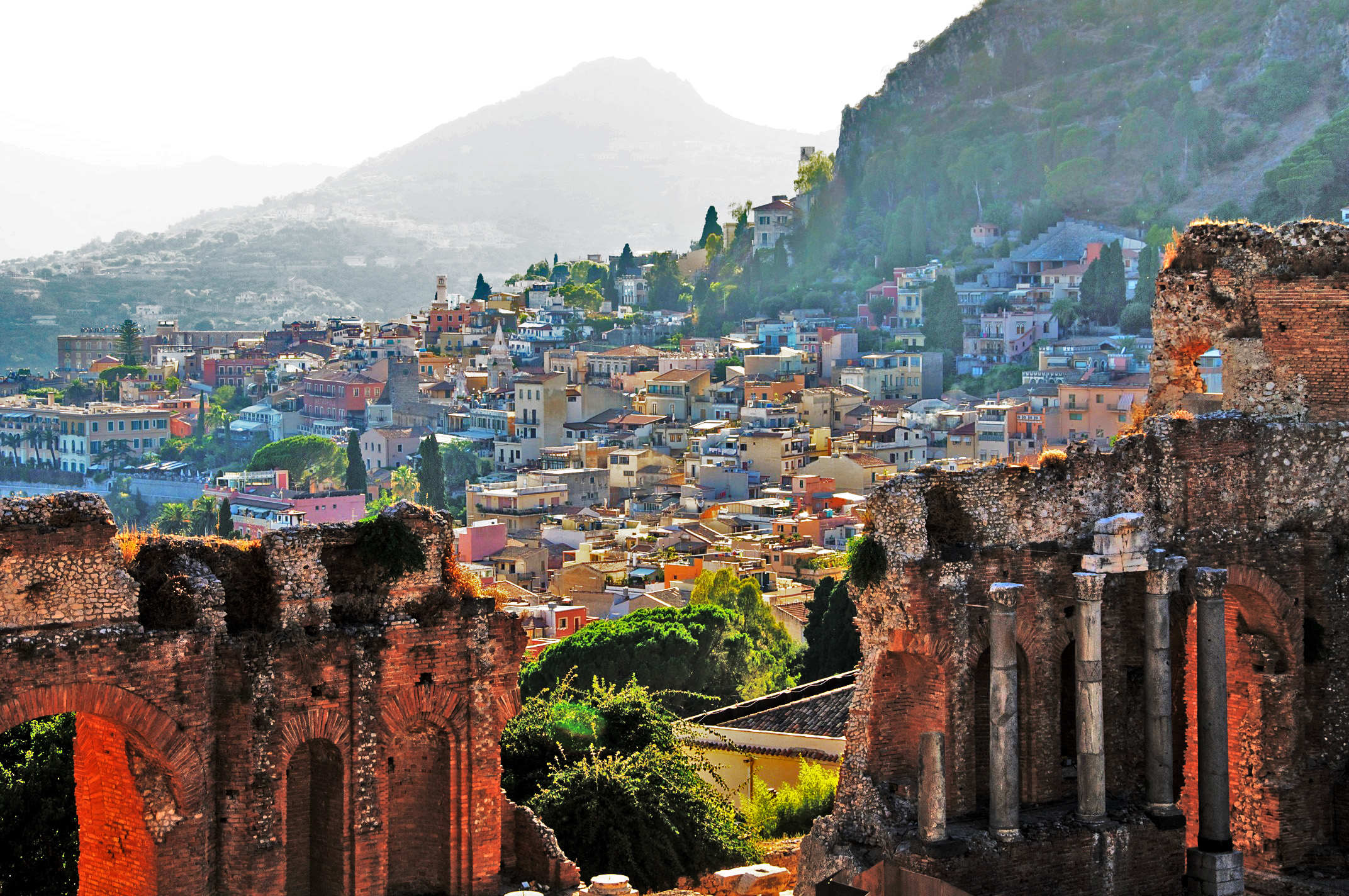 The small coastal city of Taormina, where me and my friends will be staying when we visit Sicily this summer. Image credit:    Luca Volpi   /   Flickr