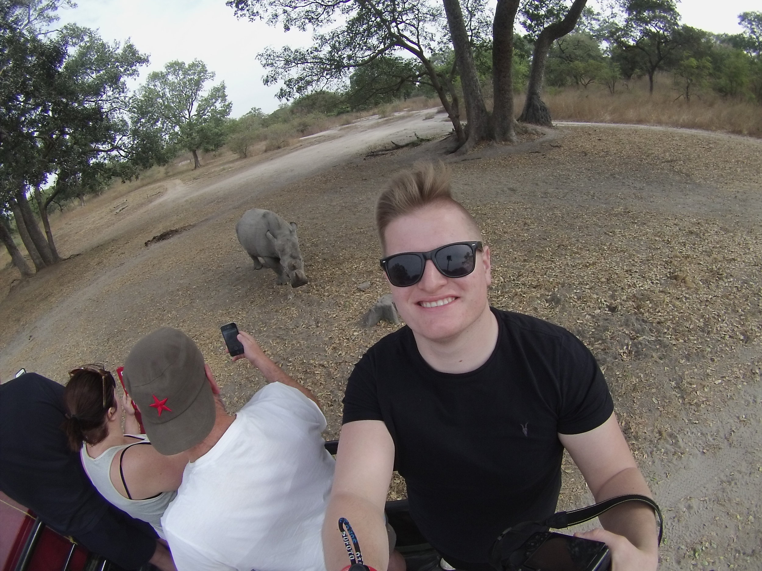 Getting a selfie with a rhino at Fathala Game Reserve in Senegal.