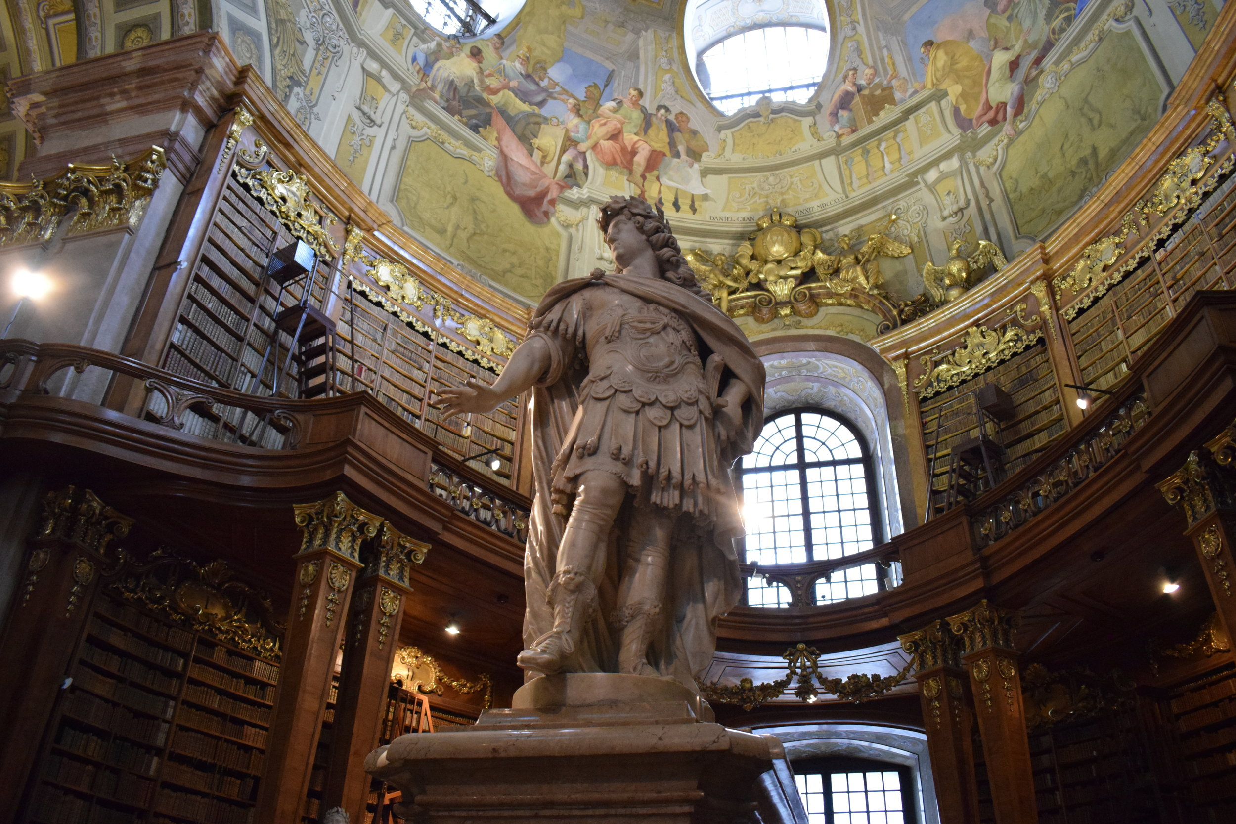 A statue standing inside the Austrian National Library's incredible State Hall.