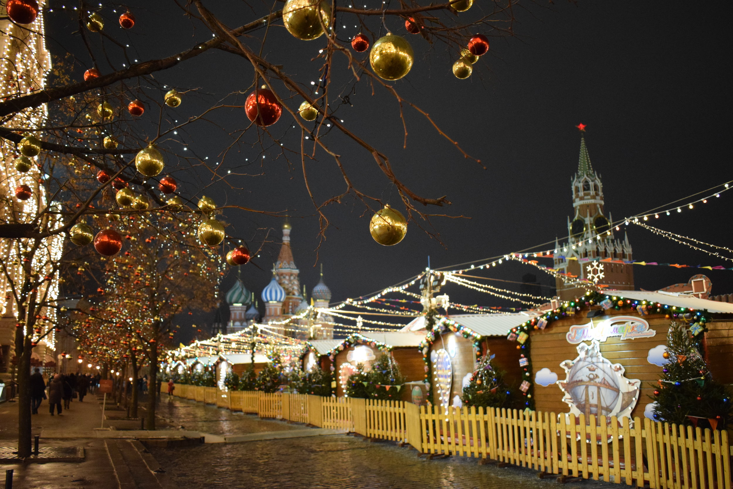 Red Square Christmas Market set against the backdrop of Saint Basil's Cathedral and the Kremlin.