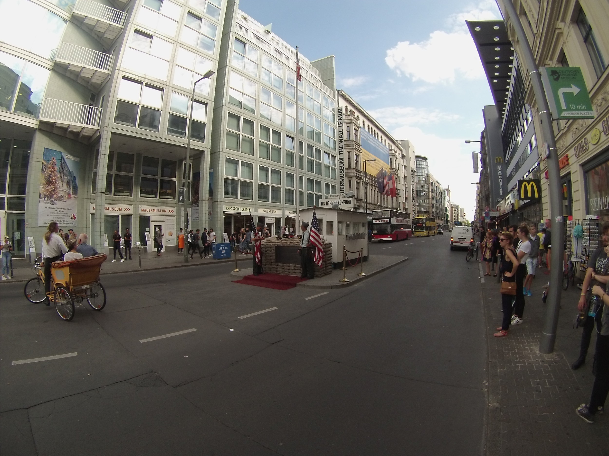 Surveying the scene at Checkpoint Charlie.