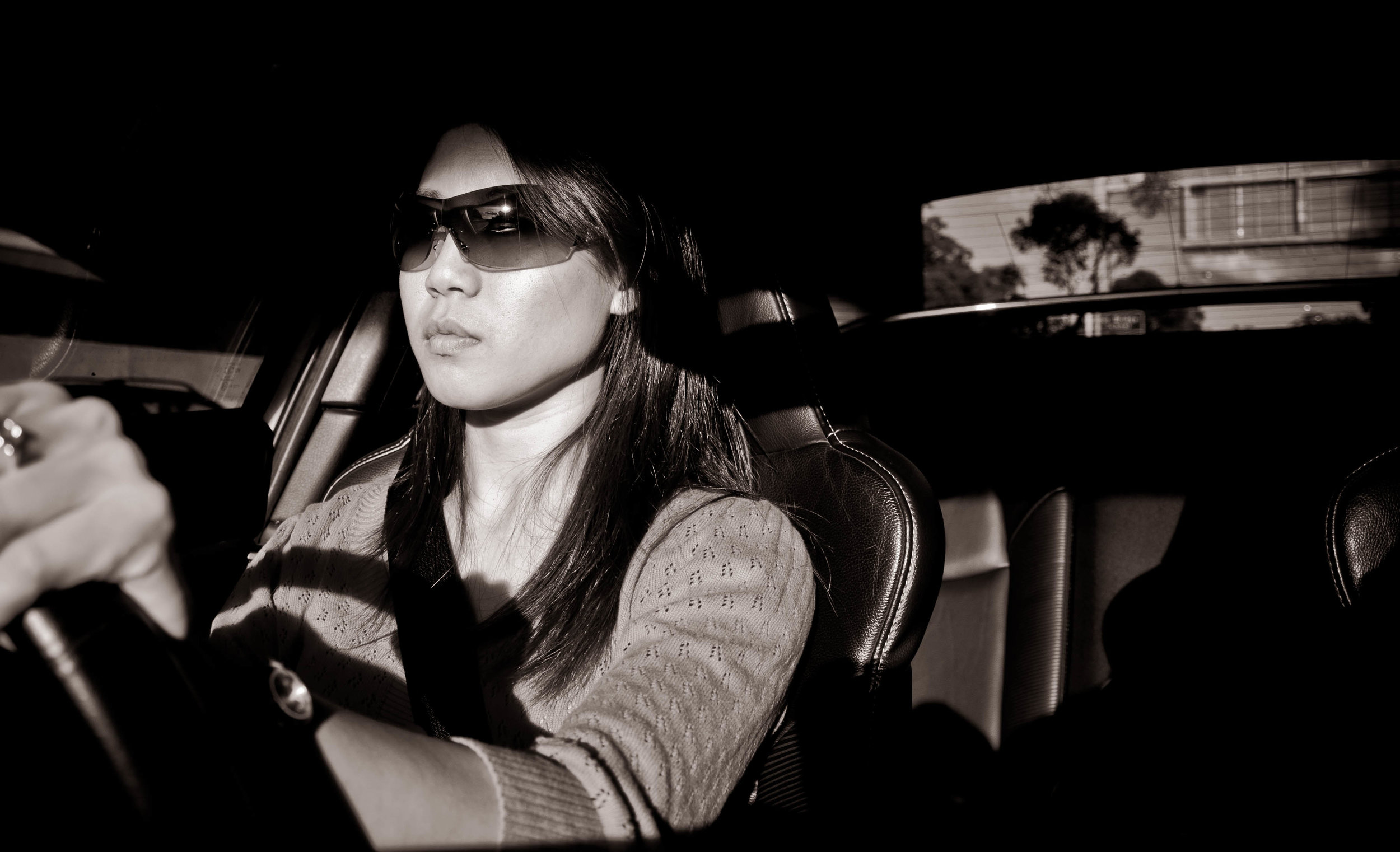 A woman driving a car. Image credit:  Eric Chu / Creative Commons