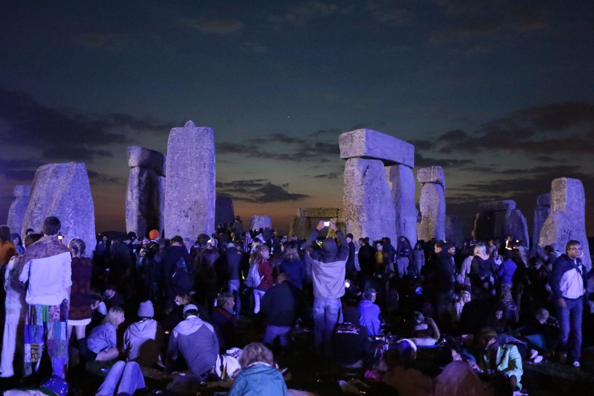 People celebrating the summer solstice at Stonehenge. Image credit:  Chris Stevenson / Creative Commons