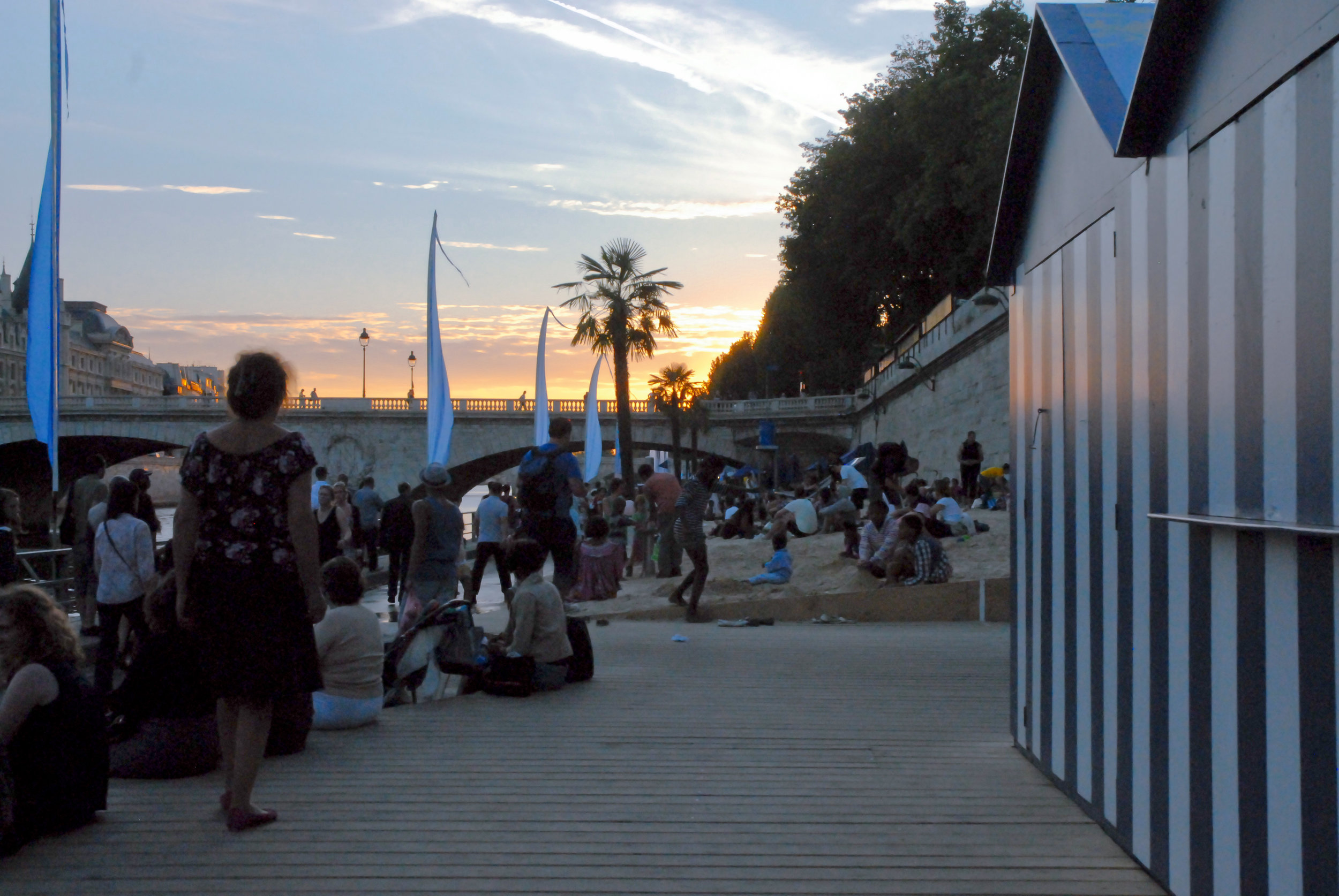 Each year a section of the River Seine's embankment is transformed into a city centre beach in Paris. Image credit:  François-Digital / Creative Commons