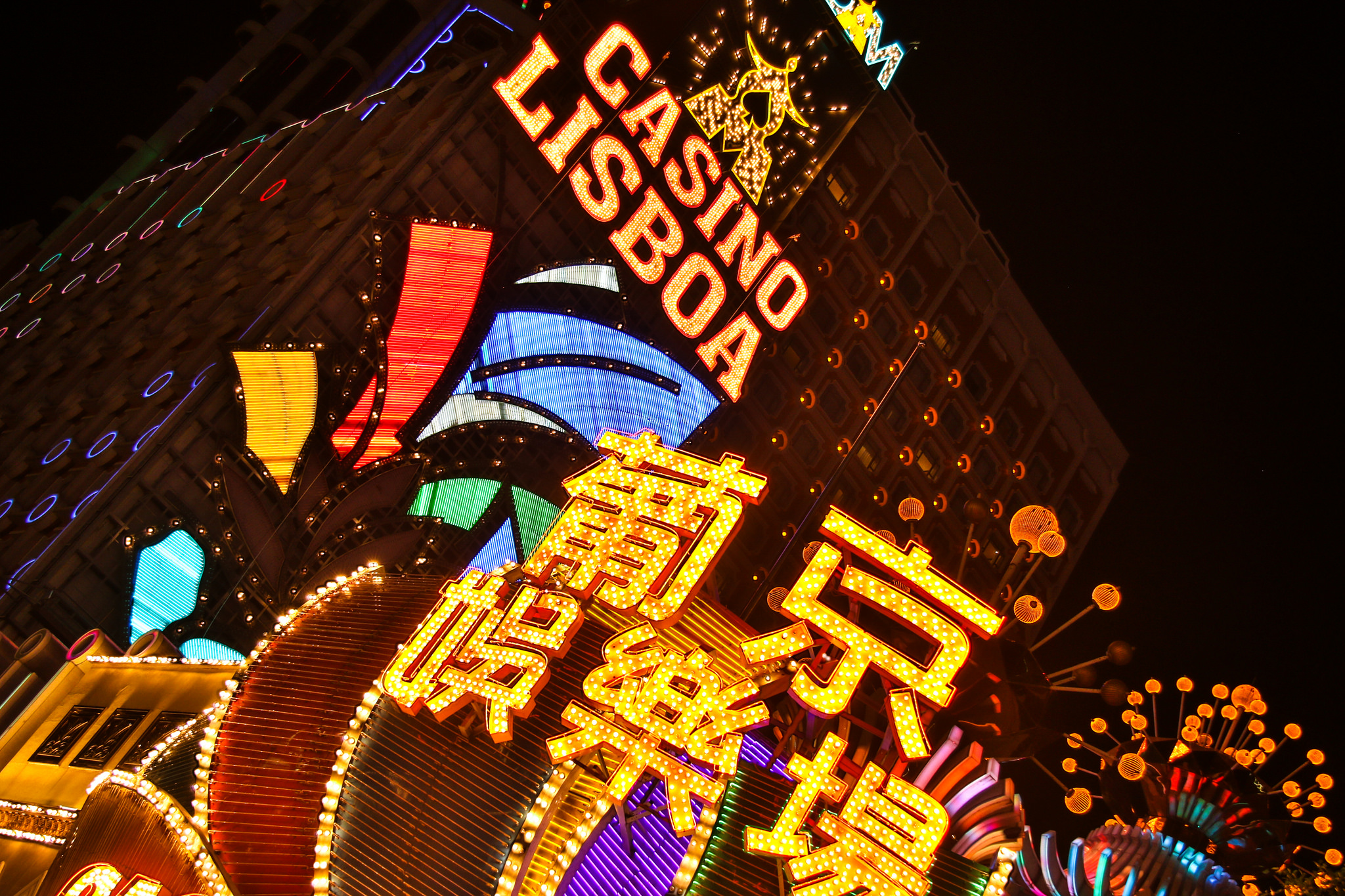 The bright lights of Macau and a casino named after the capital of Portugal, of which this Chinese city used to be a part. Image credit:  Andrew Moore / Creative Commons