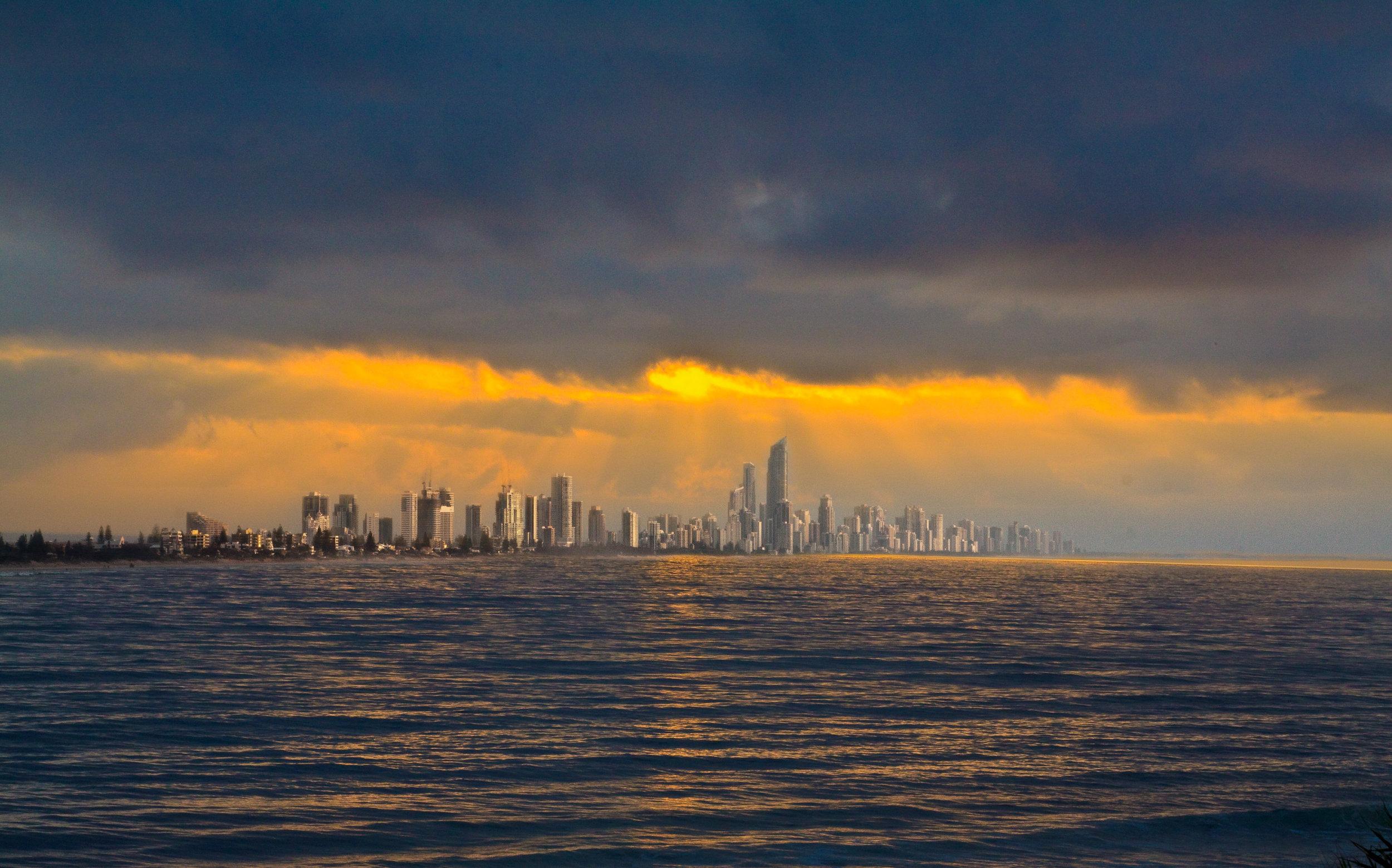 Gold Coast's skyline dancing under the glow of an Australian sunrise. Image credit:    Michael Dawes   /   Creative Commons