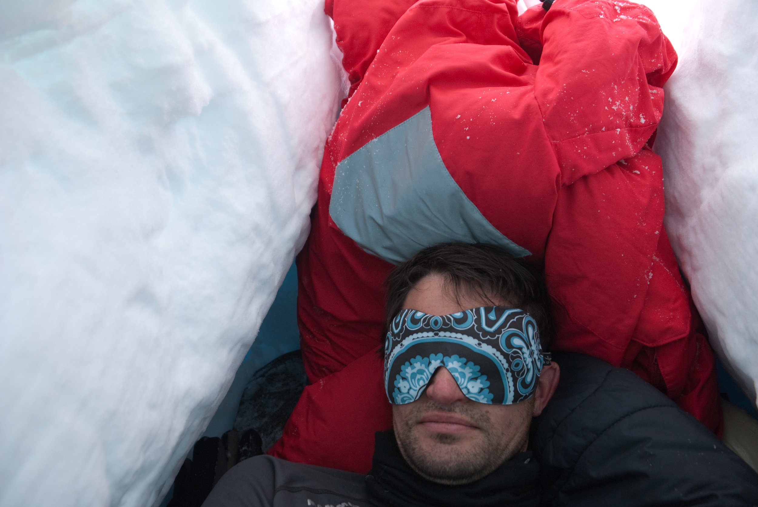 A camper uses a face mask to help him sleep. Image credit:    brookpeterson   /   Creative Commons